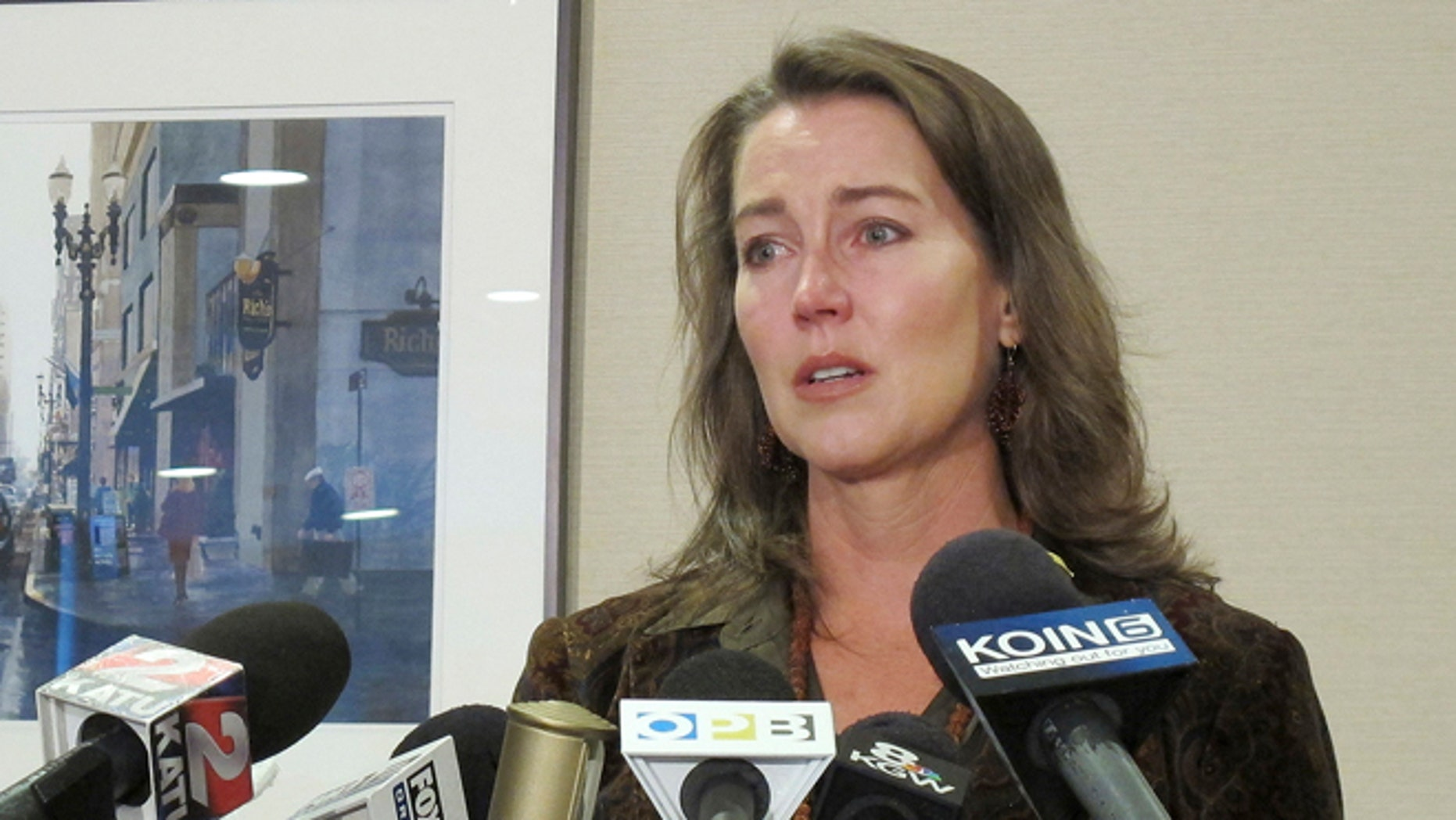 In this Thursday, Oct. 9, 2014 photo, Cylvia Hayes, fiancee of Oregon Gov. John Kitzhaber, speaks at a news conference in Portland, Ore.