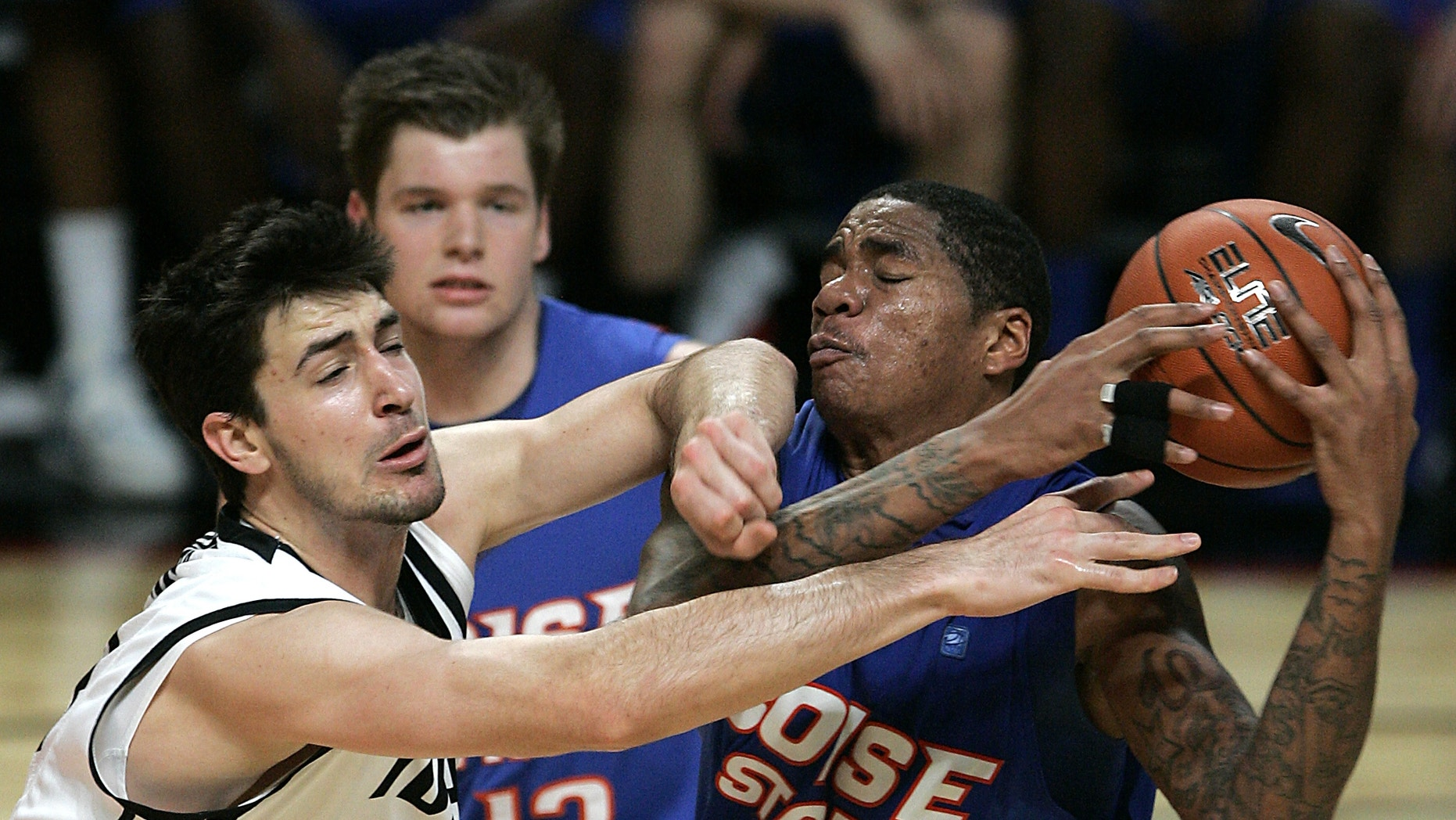 Idaho's Kyle Barone, left, and Boise State's Kenny Buckner (42) go after a loose ball during the first half of an NCAA college basketball game on Thursday, Dec. 20, 2012, in Boise, Idaho. (AP Photo/Matt Cilley)