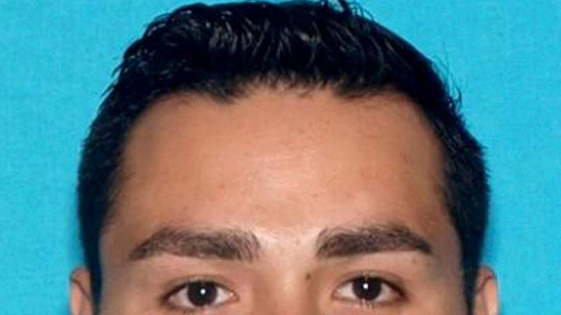 FILE - This undated file photo provided by the Pomona, Calif., Police Department shows Henry Solis. The rookie Los Angeles police officer charged with murder in the killing of a man during an off-duty fight fled with the help of his father to Texas where the men have family, according to a federal arrest warrant filed Thursday, March 19, 2015. The document says Solis called his father, Victor Solis of Lancaster, for help after a brawl outside a downtown Pomona bar early Friday in which Salome Rodriguez was shot multiple times and killed. (AP Photo/Pomona Police Department, File)
