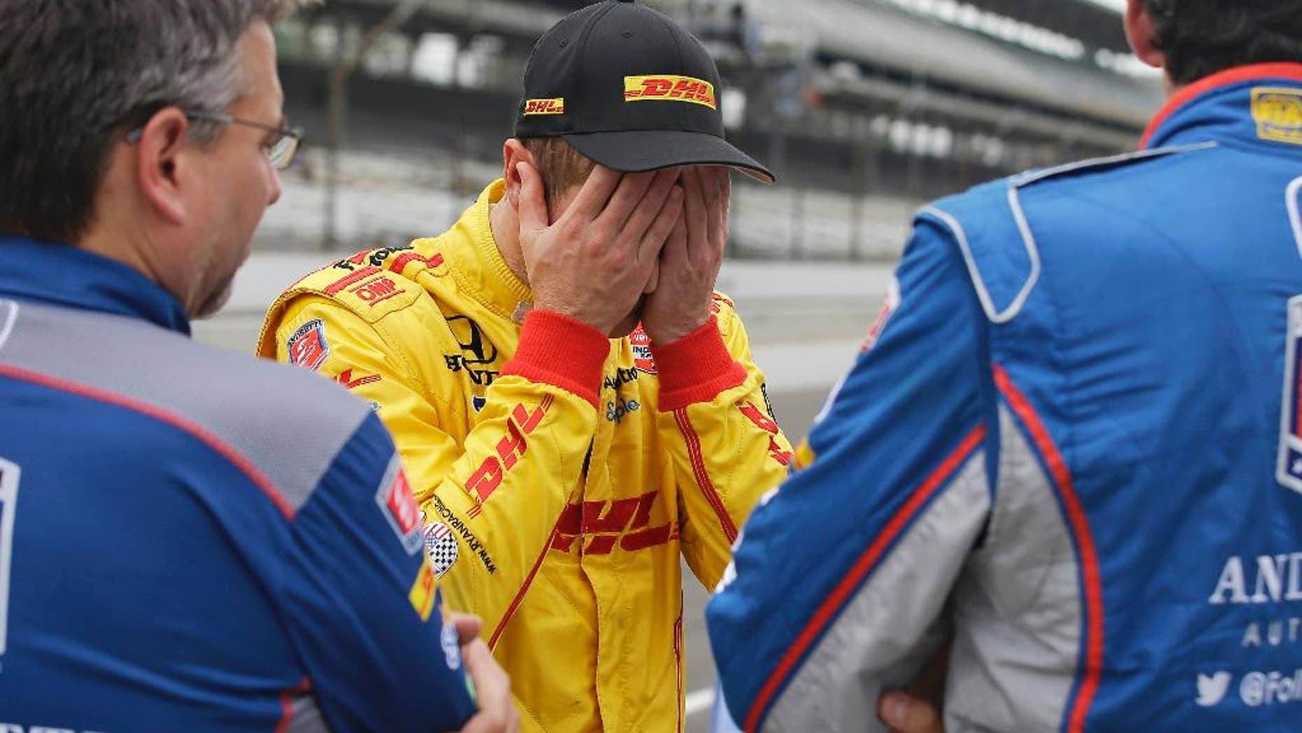 Ryan Hunter-Reay reacts after watching the wreck of James Hinchcliffe, of Canada, during practice for the Indianapolis 500 auto race at Indianapolis Motor Speedway in Indianapolis, Monday, May 18, 2015.  (AP Photo/Darron Cummings)