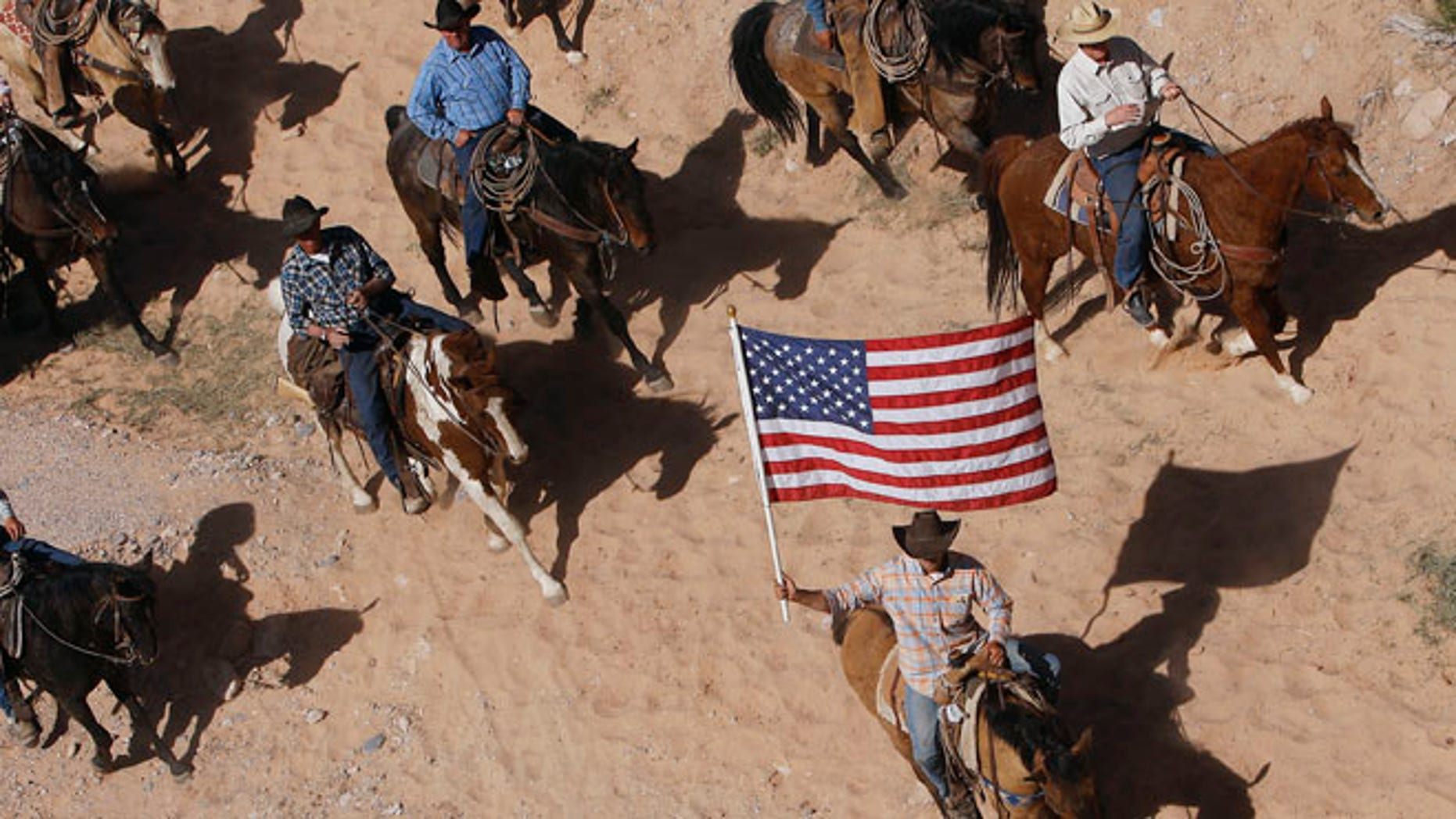 April 12, 2014: The Bundy family and their supporters fly the American flag as their cattle is released by the Bureau of Land Management.