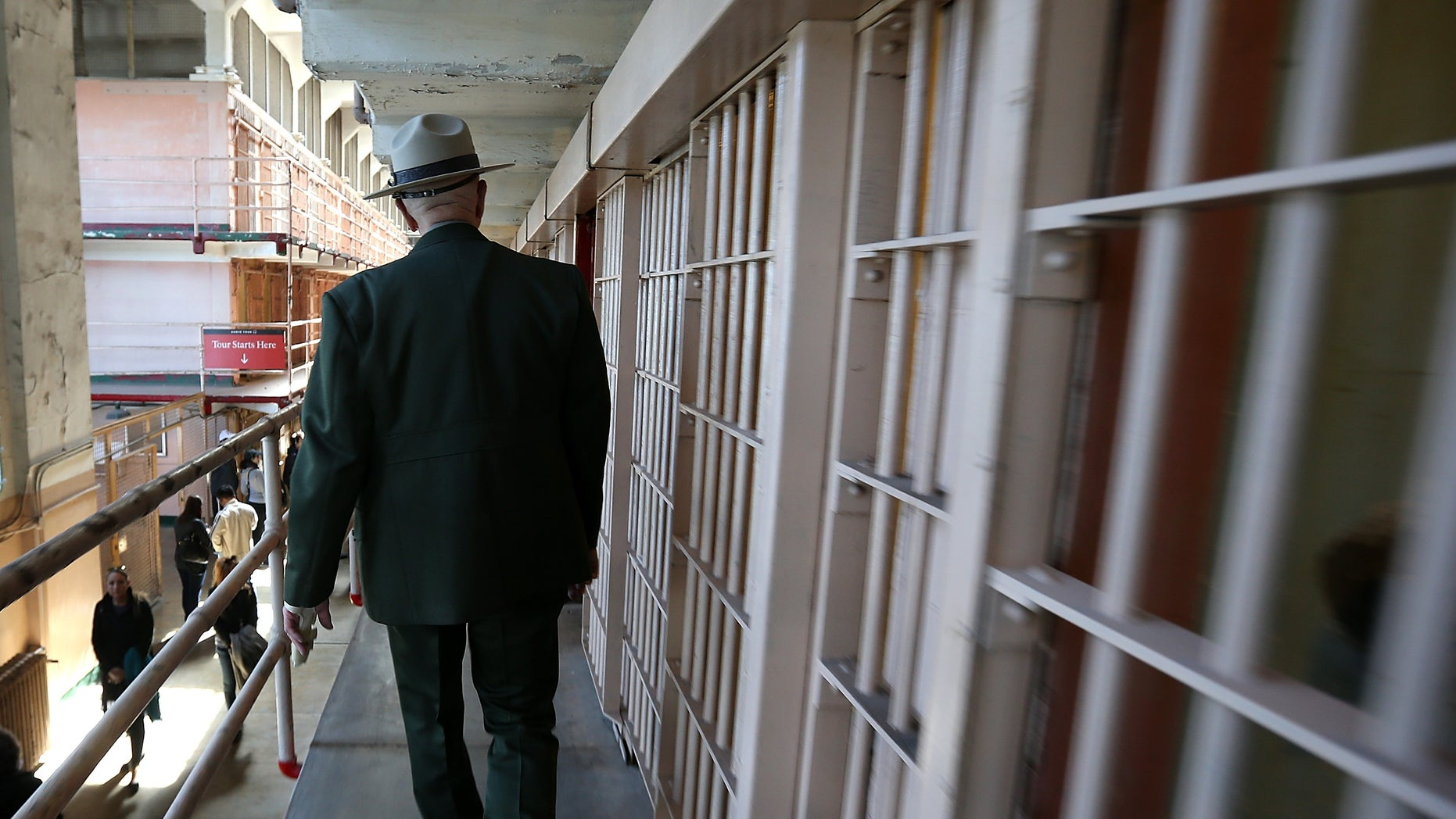 SAN FRANCISCO, CA - MARCH 21:  National Park Service ranger Roger Goldberg walks through the main cell block at Alcatraz Island on March 21, 2013 in San Francisco, California.  The National Park Service marked the 50th anniversary of the closure of the notorius Alcatraz federal penitentiary with an exhibit of newly discovered photos by Los Angeles freelance photographer Leigh Wiener of the prison's final day in 1963. Alcatraz was first a fort and later became an Army disciplinary barracks before being taken over by the Bureau of Prisons in 1934.  (Photo by Justin Sullivan/Getty Images)