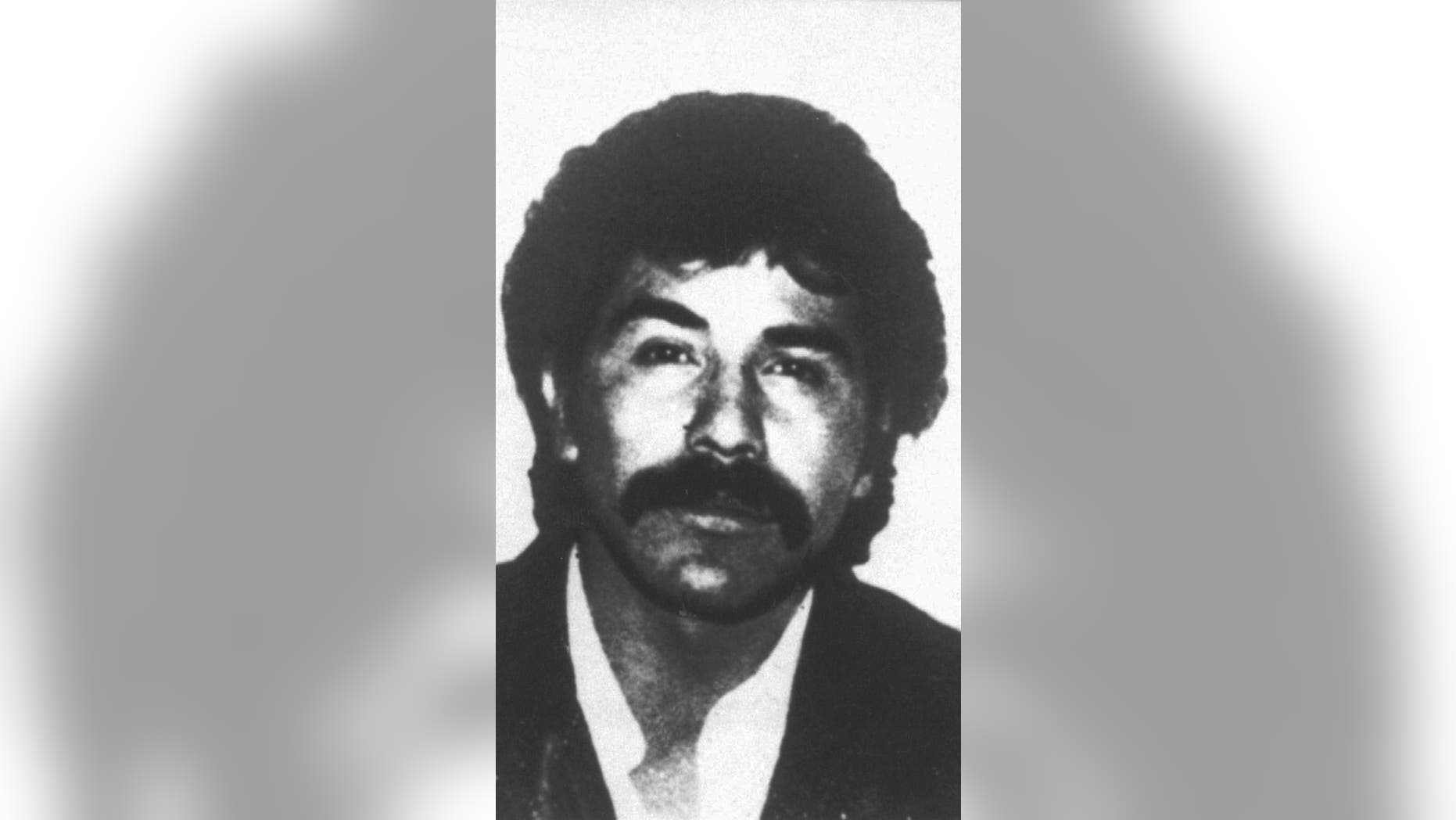 FILE - This undated file photo provided by Mexico's government shows drug lord Rafael Caro Quintero in an unknown location. Chihuahua Attorney General Jorge Gonzalez told reporters on Monday, July 4, 2016 that the old-guard drug lord mistakenly released in 2013 is apparently trying to get back into the drug trade. (Mexico's government via AP/File)