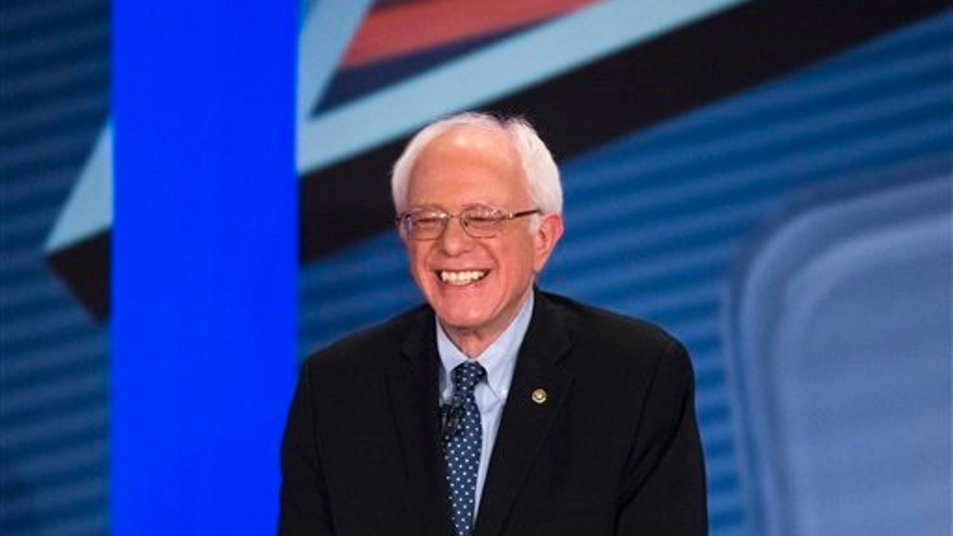 Democratic presidential candidate Sen. Bernie Sanders, I-Vt., smiles as he answers a question from the audience alongside host Anderson Cooper during a democratic primary town hall sponsored by CNN, Wednesday, Feb. 3, 2016, in Derry, N.H. (AP Photo/John Minchillo)
