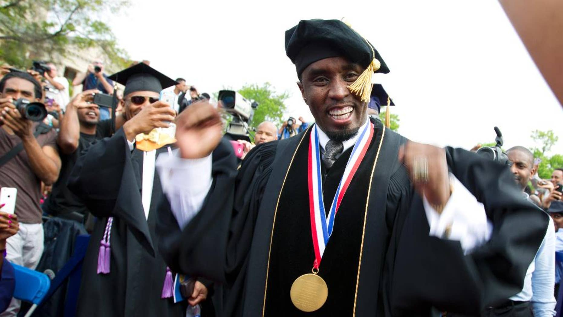 "FILE - In this May 10, 2014, file photo, entertainer and entrepreneur Sean ""Puff Daddy"" Combs arrives to the 2014 Howard University graduation ceremony at Howard University in Washington. Combs announced a $1 million donation to the school on Sept. 23, 2016, during his concert in Washington. (AP Photo/Jose Luis Magana, File)"