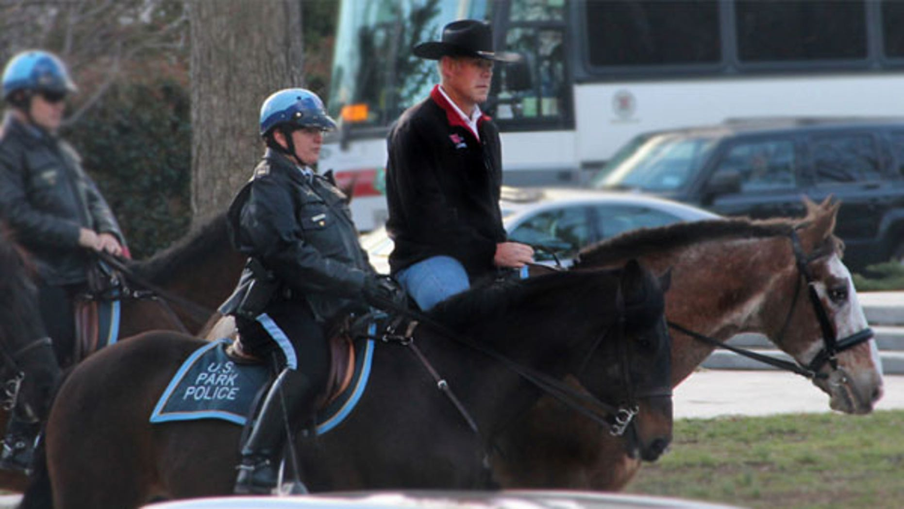 In this photo provided by the Interior Department shows Interior Secretary Ryan Zinke arriving for his first day of work at the Interior Department in Washington