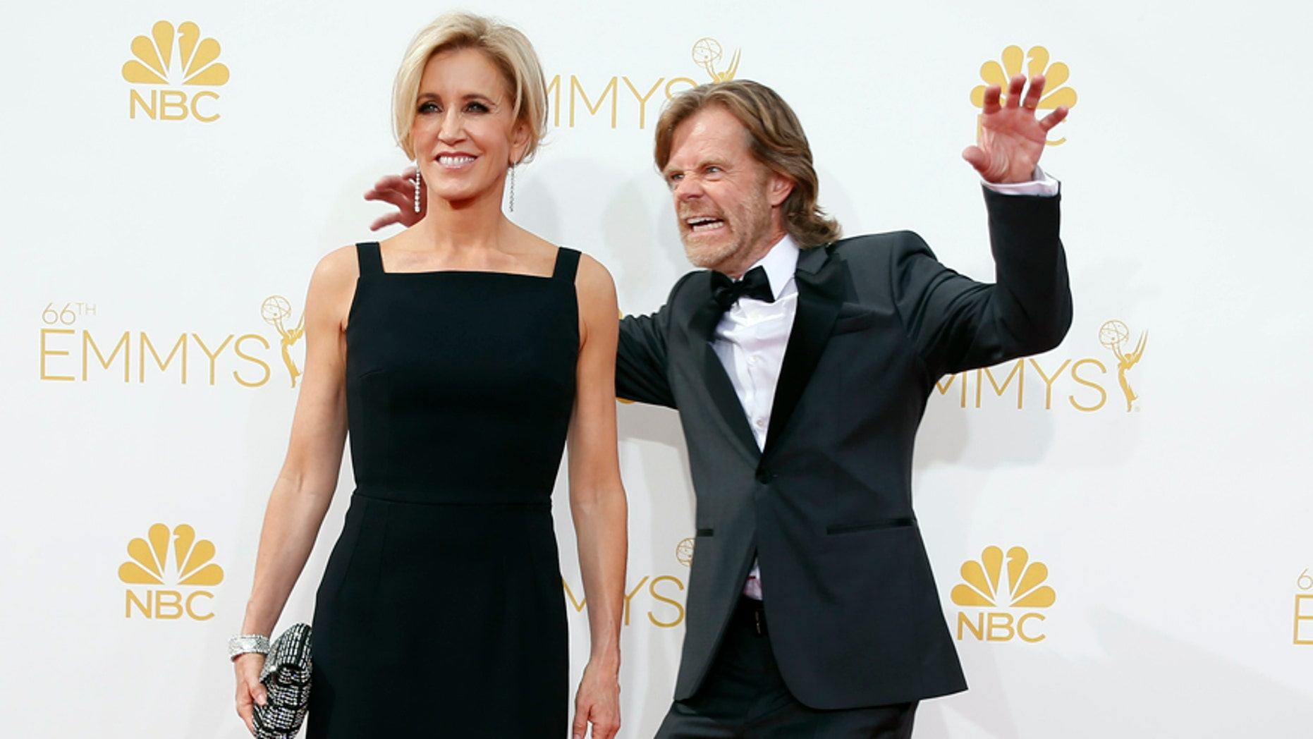 """William H. Macy from the Showtime series """"Shameless"""" and his wife, Felicity Huffman, arrive at the 66th Primetime Emmy Awards in Los Angeles, California August 25, 2014.  REUTERS/Lucy Nicholson (UNITED STATES -Tags: ENTERTAINMENT)(EMMYS-ARRIVALS) - RTR43Q7X"""