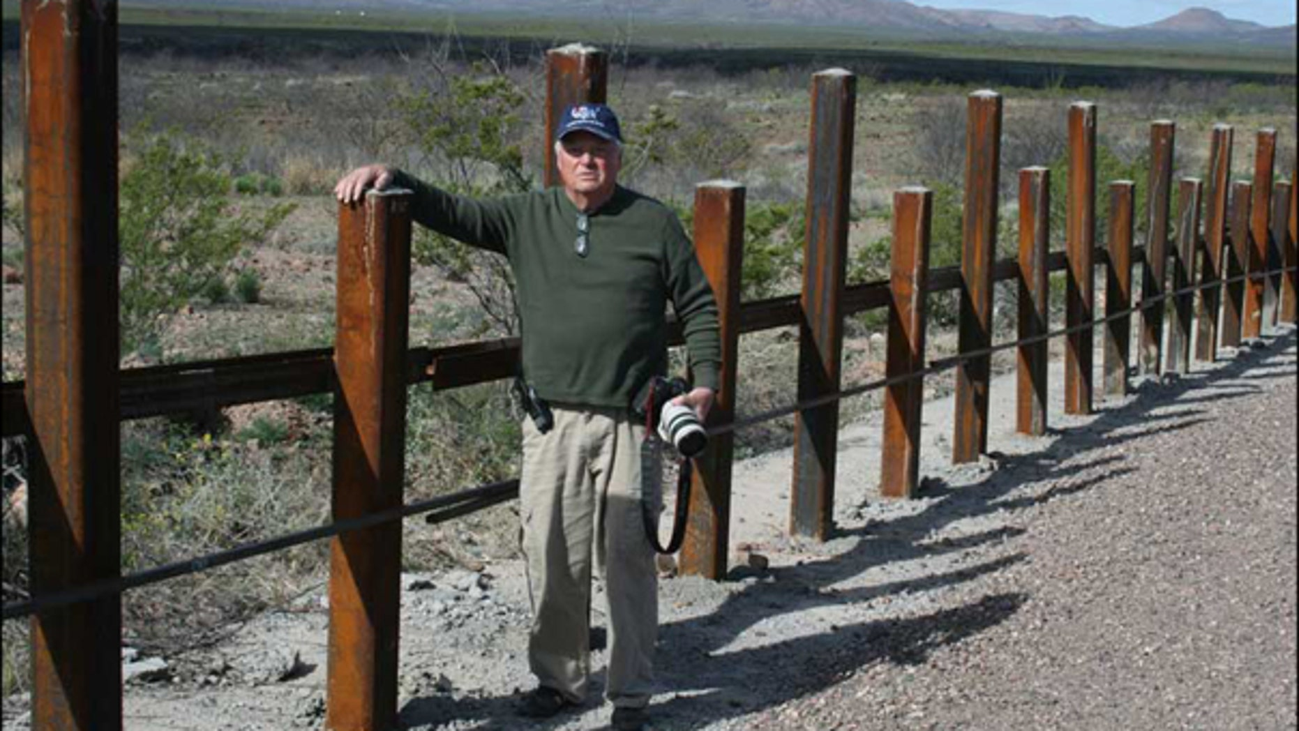 Local rancher Glenn Spencer stands by a vehicle barrier along the U.S.-Mexico border in Arizona. (Courtesy of American Border Patrol)
