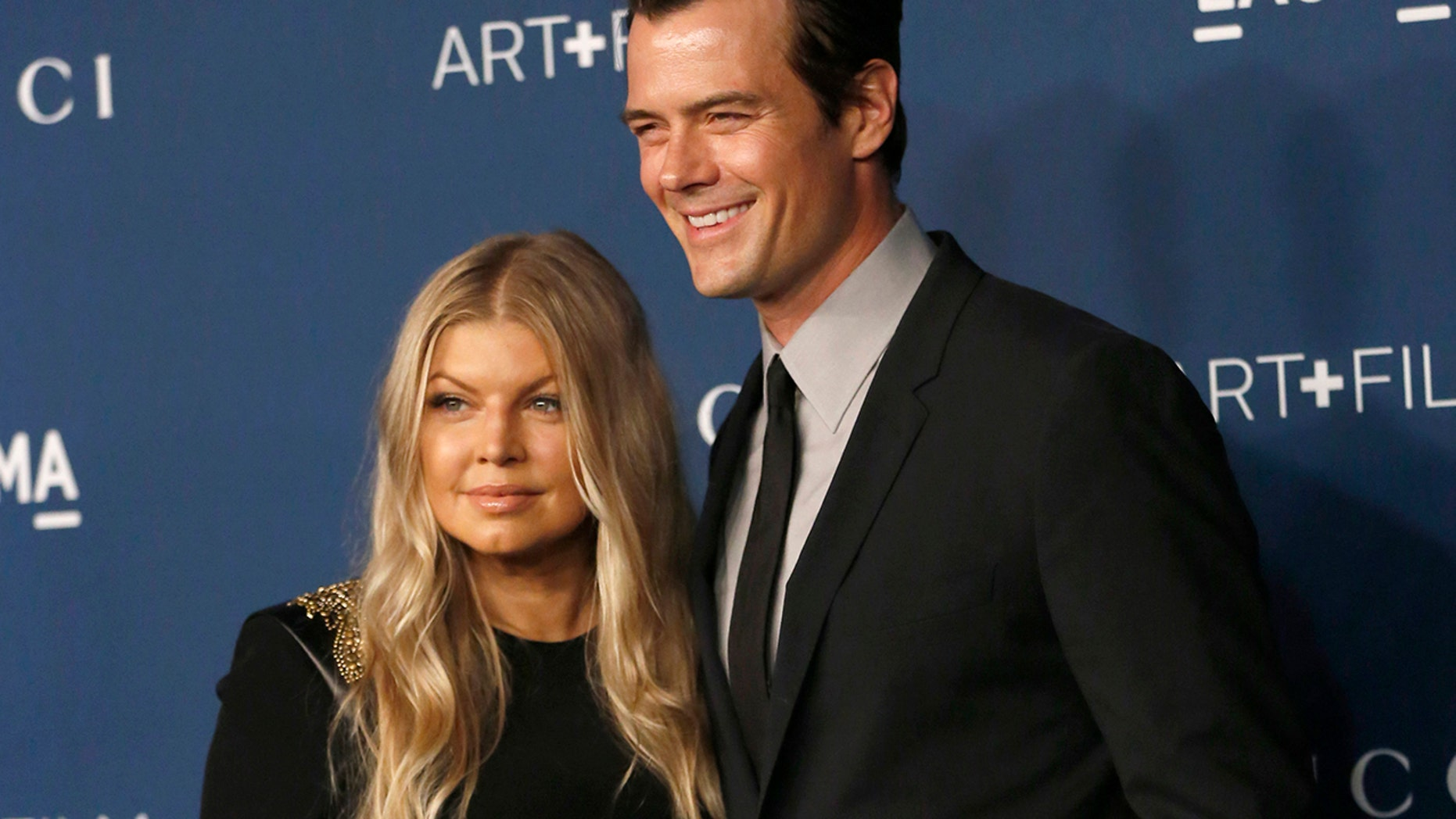 Actor Josh Duhamel and singer Fergie pose at the Los Angeles County Museum of Art (LACMA) 2013 Art+Film Gala in Los Angeles, California November 2, 2013.