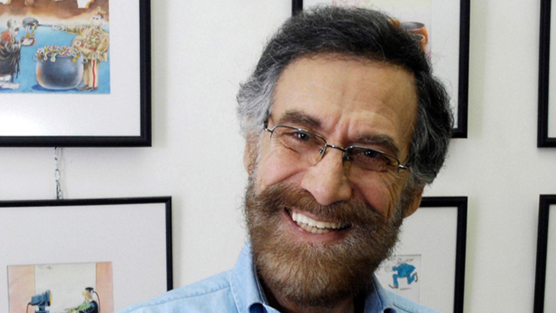 August 14: Syrian cartoonist Ali Farzat poses in his atelier in Damascus, Syria. Syrian security forces attacked renowned anti-regime cartoonist Ali Farzat early Thursday in Damascus and left him bleeding along the side of a road, human rights activists said.