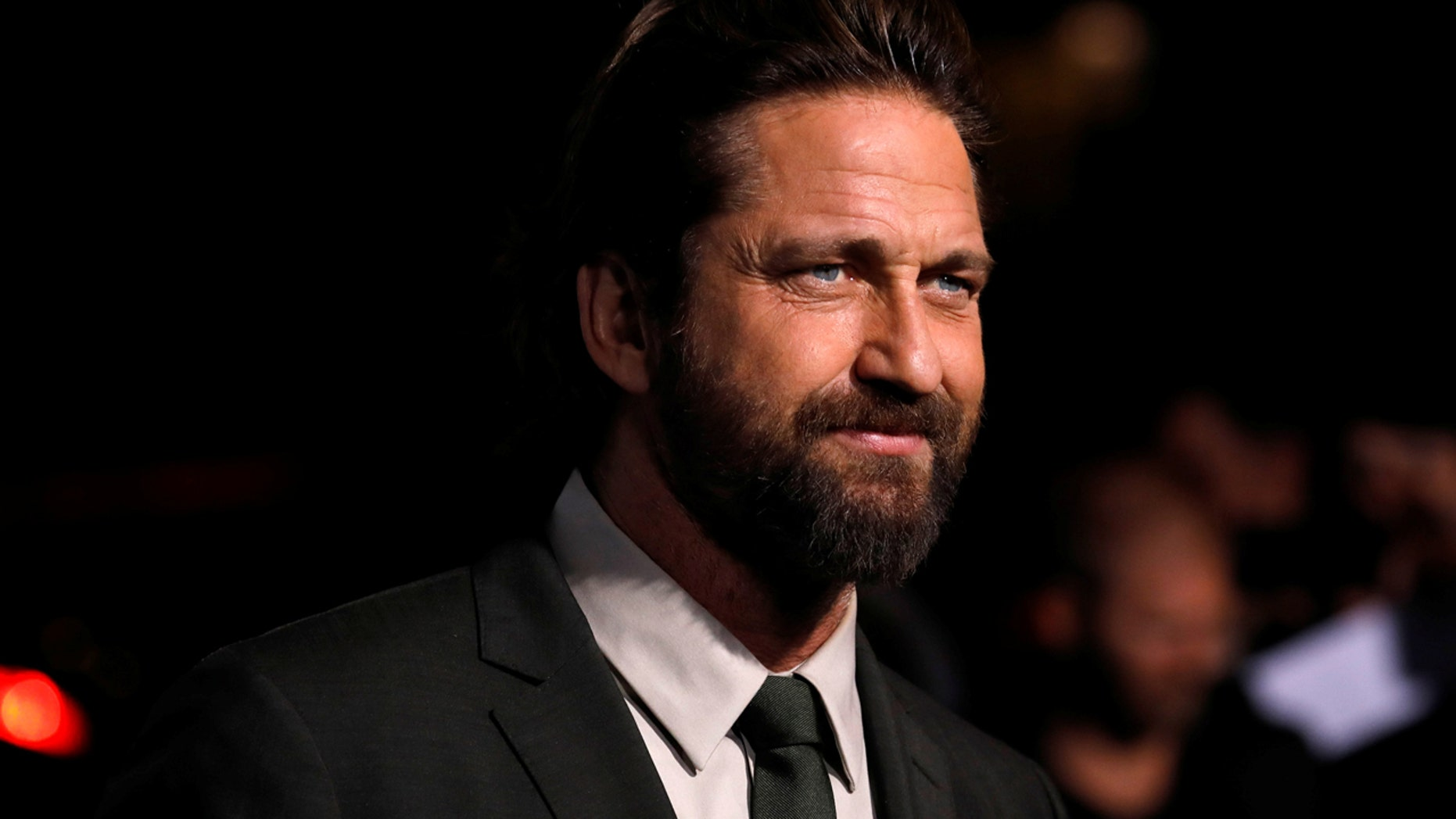 """Oct. 16: Gerard Butler poses at the premiere for """"Geostorm"""" in Los Angeles"""