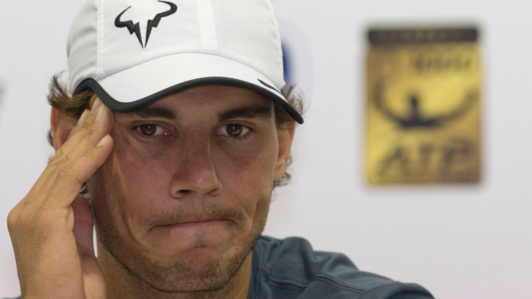 Spain's Rafael Nadal listens to questions during a press conference for the Shanghai Masters tennis tournament at the Qizhong Forest Sports City Tennis Center, in Shanghai, China, Tuesday, Oct. 8, 2013. (AP Photo/Ng Han Guan)