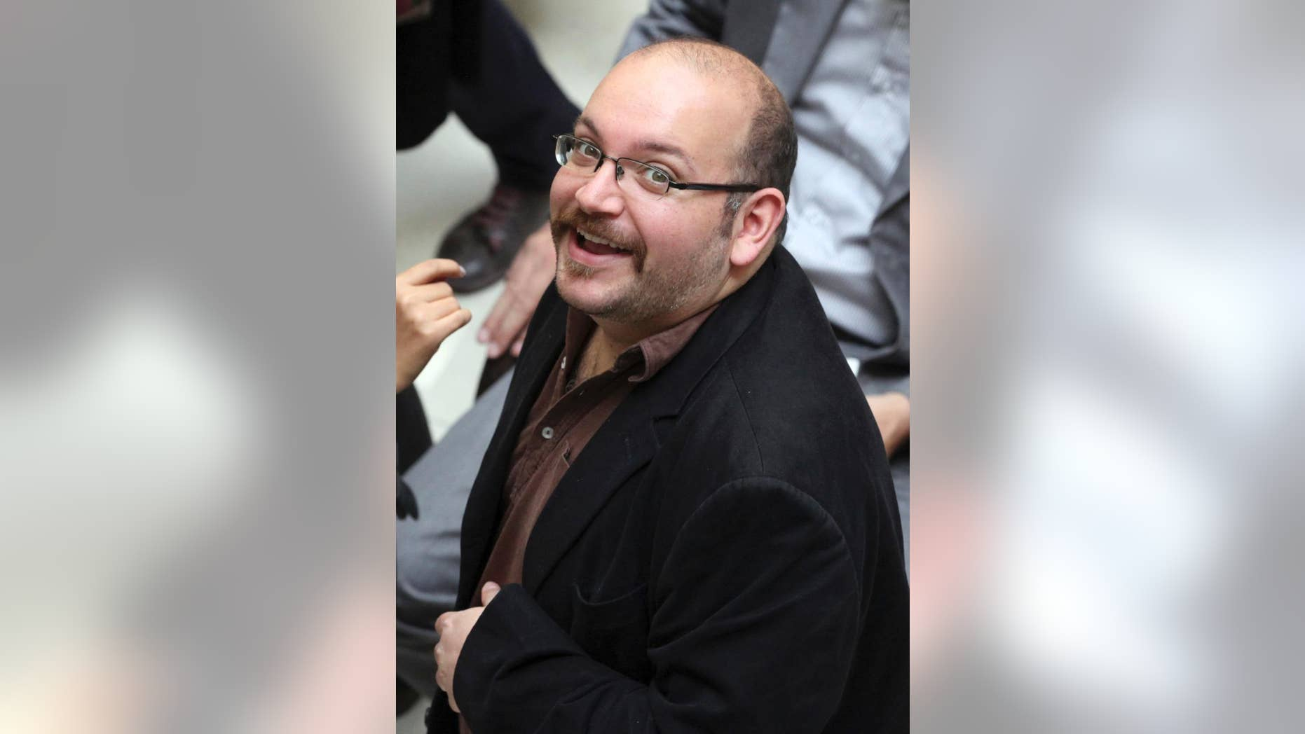 April 11, 2013: In this file photo, Jason Rezaian, an Iranian-American correspondent for the Washington Post, smiles as he attends a presidential campaign of President Hassan Rouhani in Tehran, Iran.