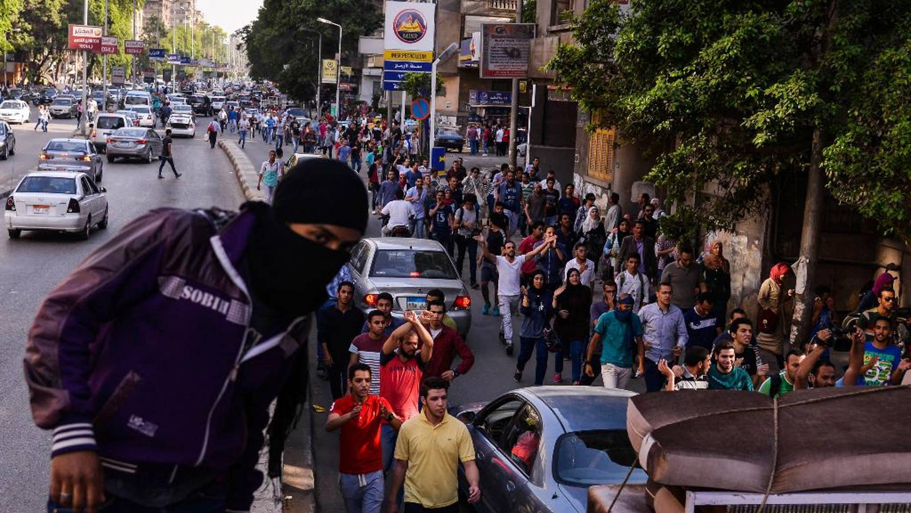Egyptians demonstrate against President Abdel-Fattah el-Sissi in Mesaha square in Cairo's Dokki district, Monday, April 25, 2016.  Police fired tear gas and birdshot on Monday to disperse hundreds of demonstrators calling on el-Sissi to step down over his government's decision to surrender control over two strategic Red Sea islands to Saudi Arabia. (AP Photo/Mostafa Darwish)