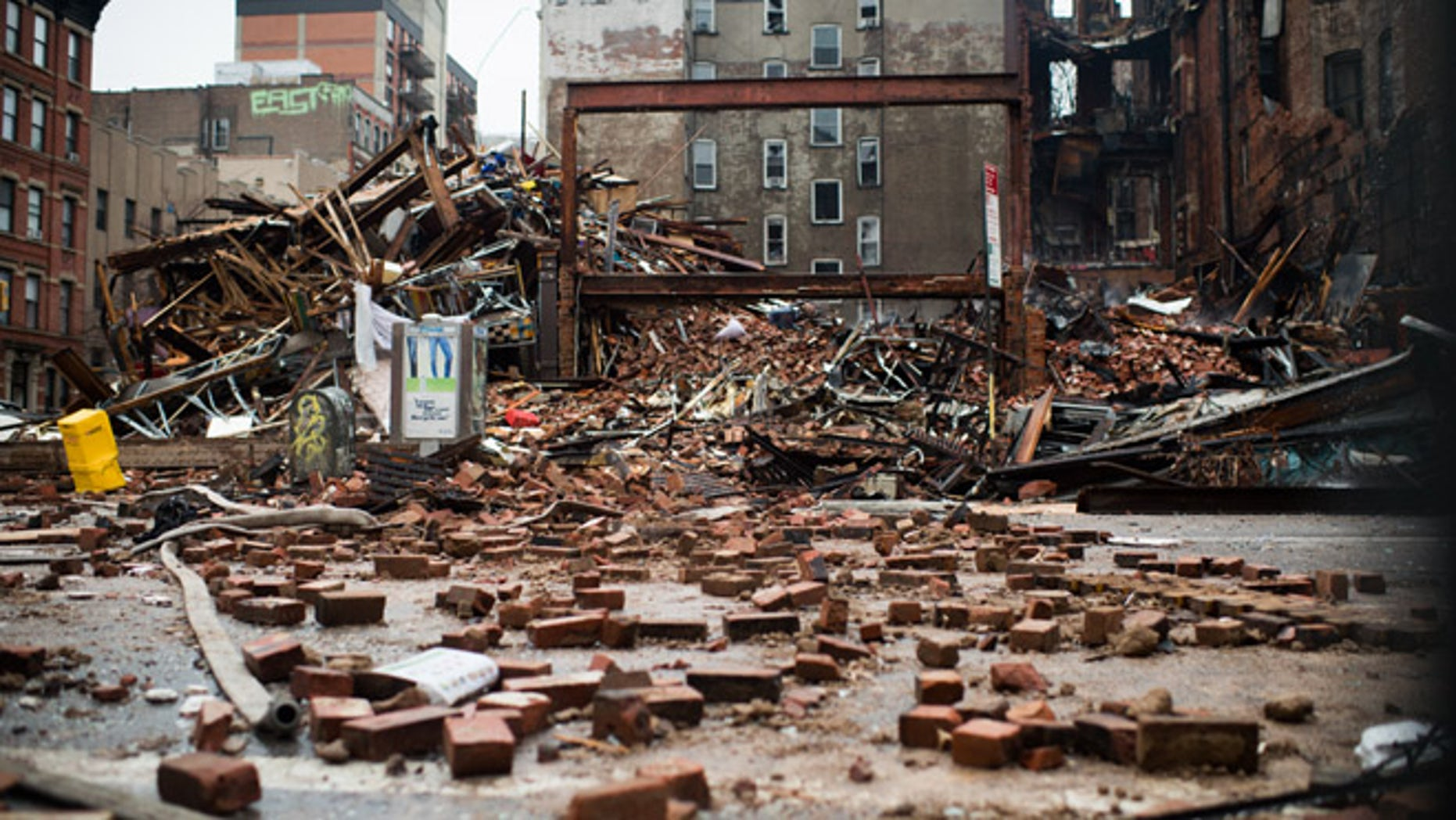 A pile of debris remains at the site of a building explosion in the East Village neighborhood of New York, Friday, March 27, 2015.  Nineteen people were injured, four critically, after the powerful blast and fire sent flames soaring and debris flying Thursday afternoon.  Preliminary evidence suggested that a gas explosion amid plumbing and gas work inside the building was to blame. (AP Photo/The New York Times, Nancy Borowick, Pool)
