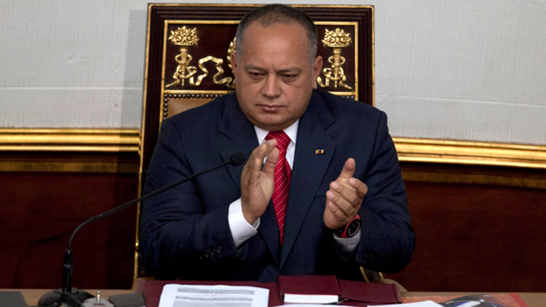 FILE - In this Jan. 5, 2013 file photo, National Assembly President Diosdado Cabello applauds before addressing the National Assembly in Caracas, Venezuela. Cabello said on Wednesday, May 13, 2015 he is asking courts to bar news executives from leaving the country while heâs suing them for alleged defamation. (AP Photo/Ariana Cubillos, File)