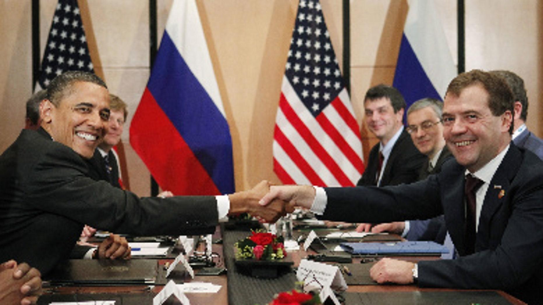 President Barack Obama and Russian President Dmitry Medvedev meet in Japan ahead of next week's NATO summit in Portugal. (AP Photo)