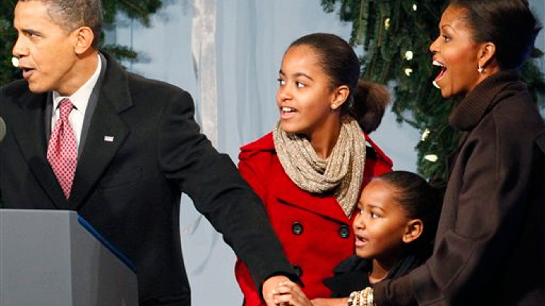 President Barack Obama, first lady Michelle Obama and daughters Sasha and Malia help to light the National Christmas Tree, Thursday, Dec. 3, 2009, in Washington. (AP Photo/Haraz N. Ghanbari)