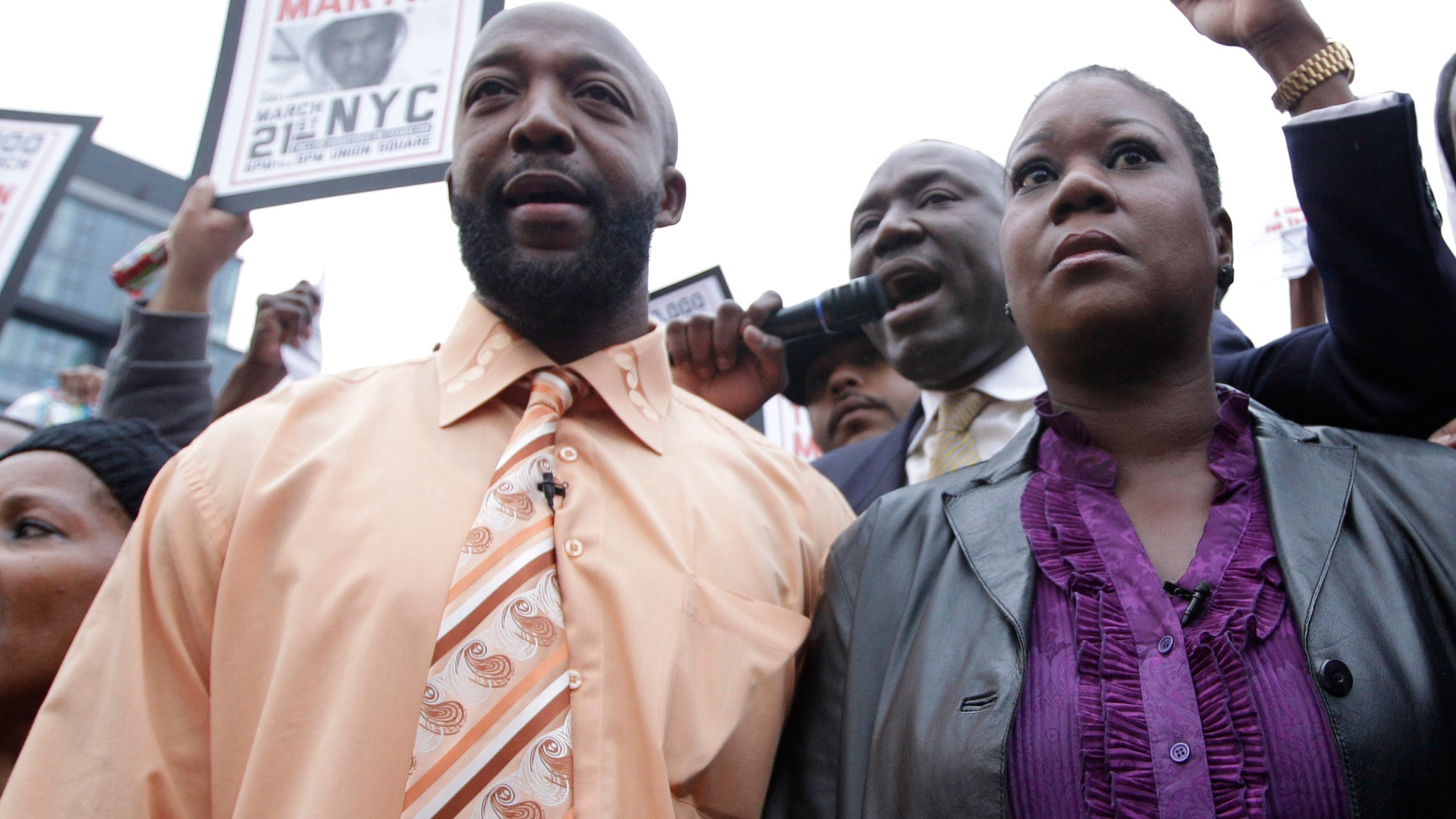 Trayvon Martin's parents Tracy Martin, left, and Sybrina Fulton, center, are joined by an unidentified woman during the Million Hoodie March in Union Square in March, 2012 in New York.