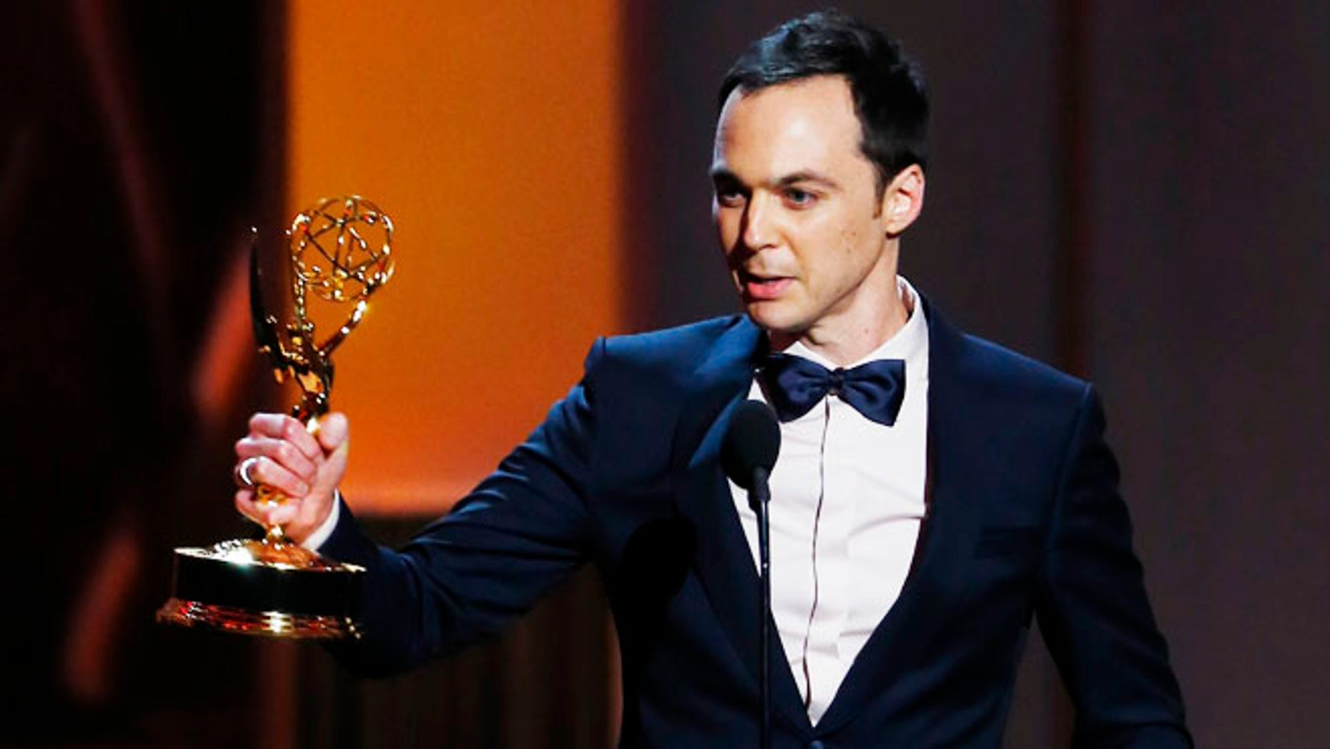 "Jim Parsons accepts the award for Outstanding Lead Actor In A Comedy Series for his role in ""The Big Bang Theory"" at the 65th Primetime Emmy Awards in Los Angeles September 22, 2013.       REUTERS/Mike Blake (UNITED STATES  - Tags: ENTERTAINMENT)   (EMMYS-SHOW) - RTX13VVS"