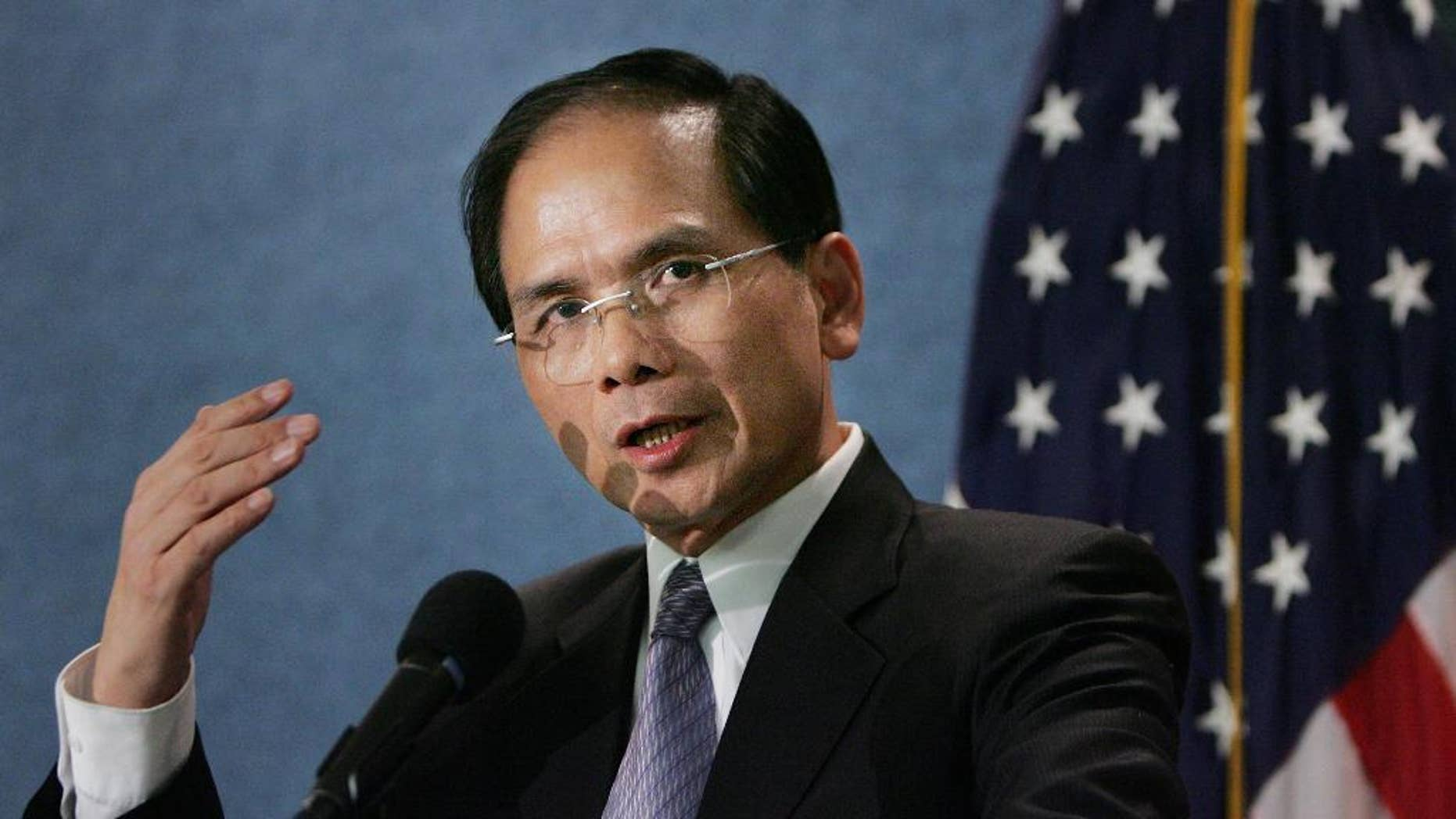 FILE - In this Tuesday, Sept. 12, 2006, file photo, Democratic Progressive Party member Yu Shyi-kun, speaks to the media during a news conference at the National Press Club in Washington DC. Yu will be joined by lawmakers and local government officials representing both Taiwan's ruling and opposition parties at Donald Trump's inauguration Friday, highlighting the unusually high profile during the presidential transition process. (AP Photo/Manuel Balce Ceneta, File)