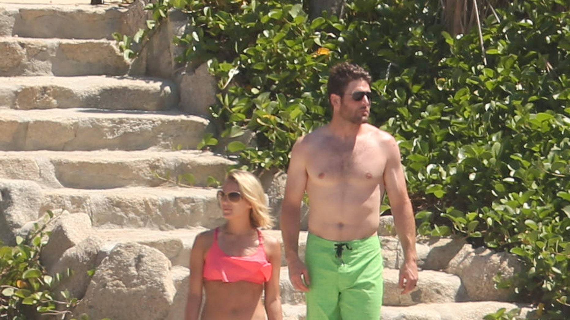 Exclusive... 52114060 Singer Carrie Underwood and her husband, Mike Fisher are seen vacationing in Cabo, Mexico on July 6, 2016. The couple was seen relaxing and soaking in the rays before dipping their feet into the ocean water. ***NO USE W/O PRIOR AGREEMENT-CALL FOR PRICING*** FameFlynet, Inc - Beverly Hills, CA, USA - +1 (310) 505-9876