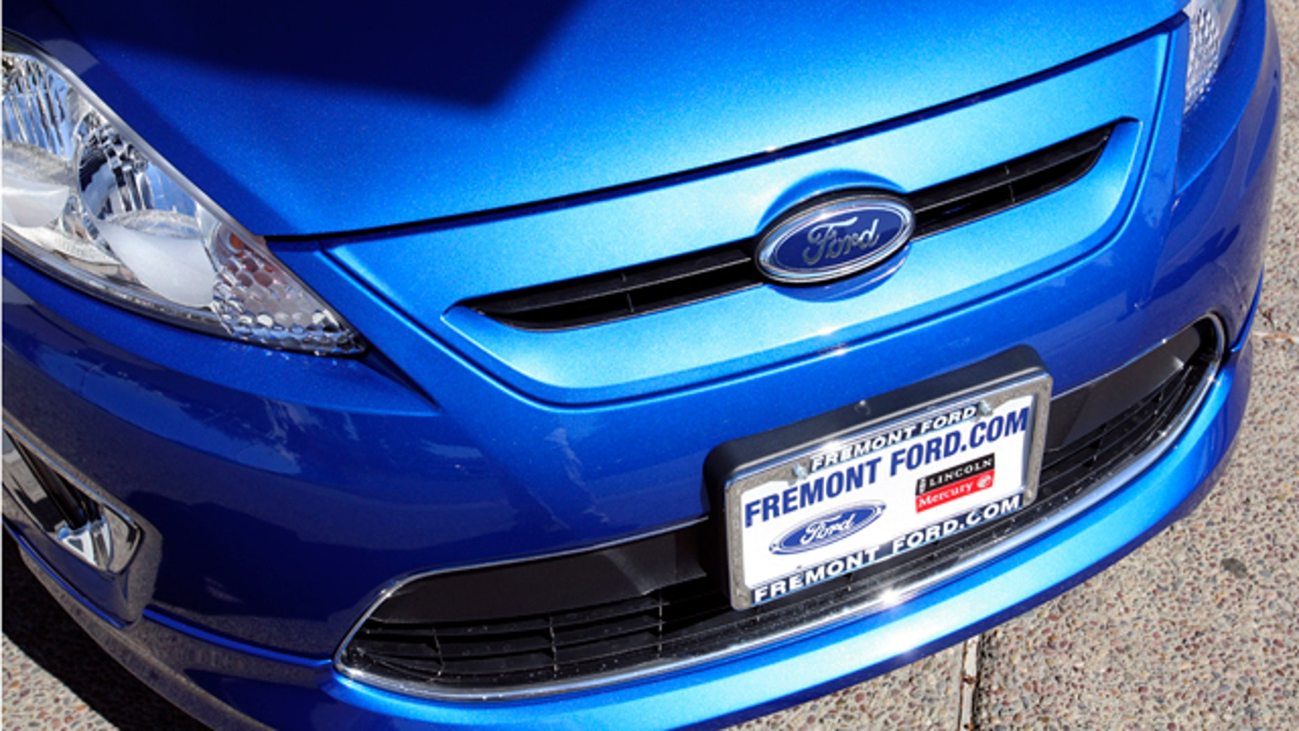"""FILE - In this Sept. 28, 2010 file photo, a 2011 Ford Fiesta vehicle is shown for sale at Fremont Ford in Newark, Calif. """"With gasoline prices eclipsing $3.90 a gallon, consumers are placing an even higher priority on fuel efficiency in every size and kind of vehicle,"""" said Ken Czubay, Ford vice president, U.S. Marketing, Sales and Service. (AP Photo/Ben Margot)"""