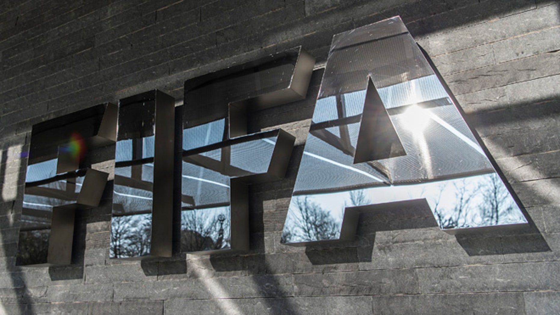 ZURICH, SWITZERLAND - MARCH 18: A FIFA sign at the entrance of its headquarters on March 18, 2016 in Zurich, Switzerland. (Photo by Valeriano Di Domenico/Getty Images)