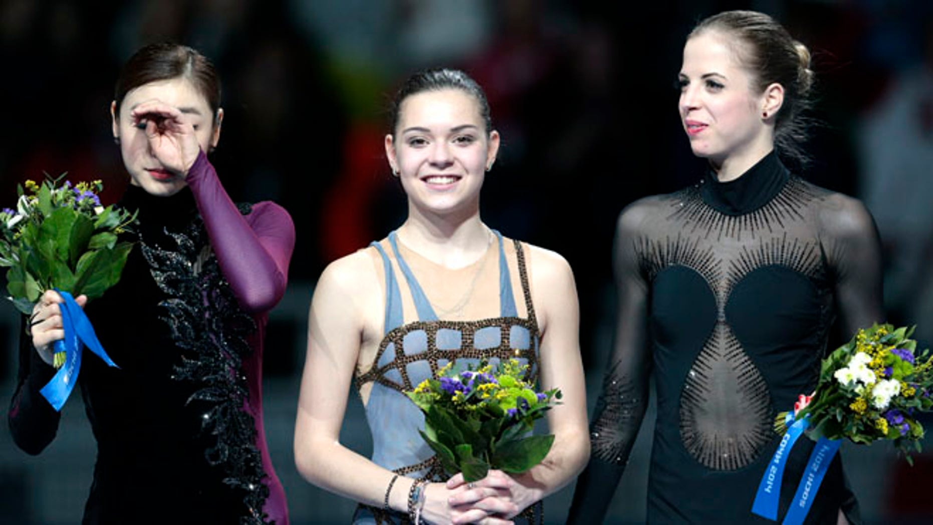 Feb. 20, 2014: Adelina Sotnikova of Russia, centre, Yuna Kim of South Korea, left, and Carolina Kostner of Italy stand on the podium during the flower ceremony for the women's free skate figure skating final at the Iceberg Skating Palace during the 2014 Winter Olympics in Sochi, Russia. Sotnikova placed first, followed by Kim and Kostner.