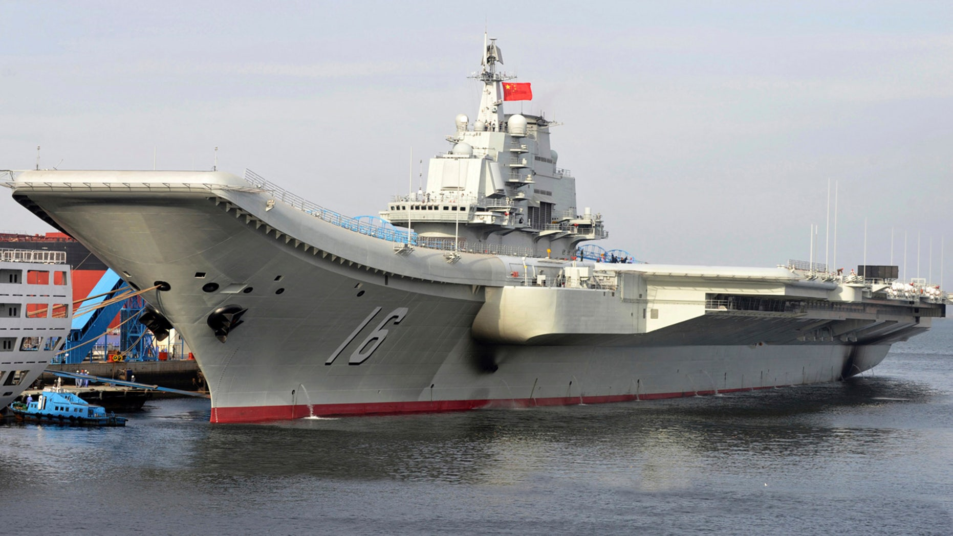 FILE - In this undated file photo released by China's Xinhua News Agency, China's aircraft carrier Liaoning berths in a port of China.