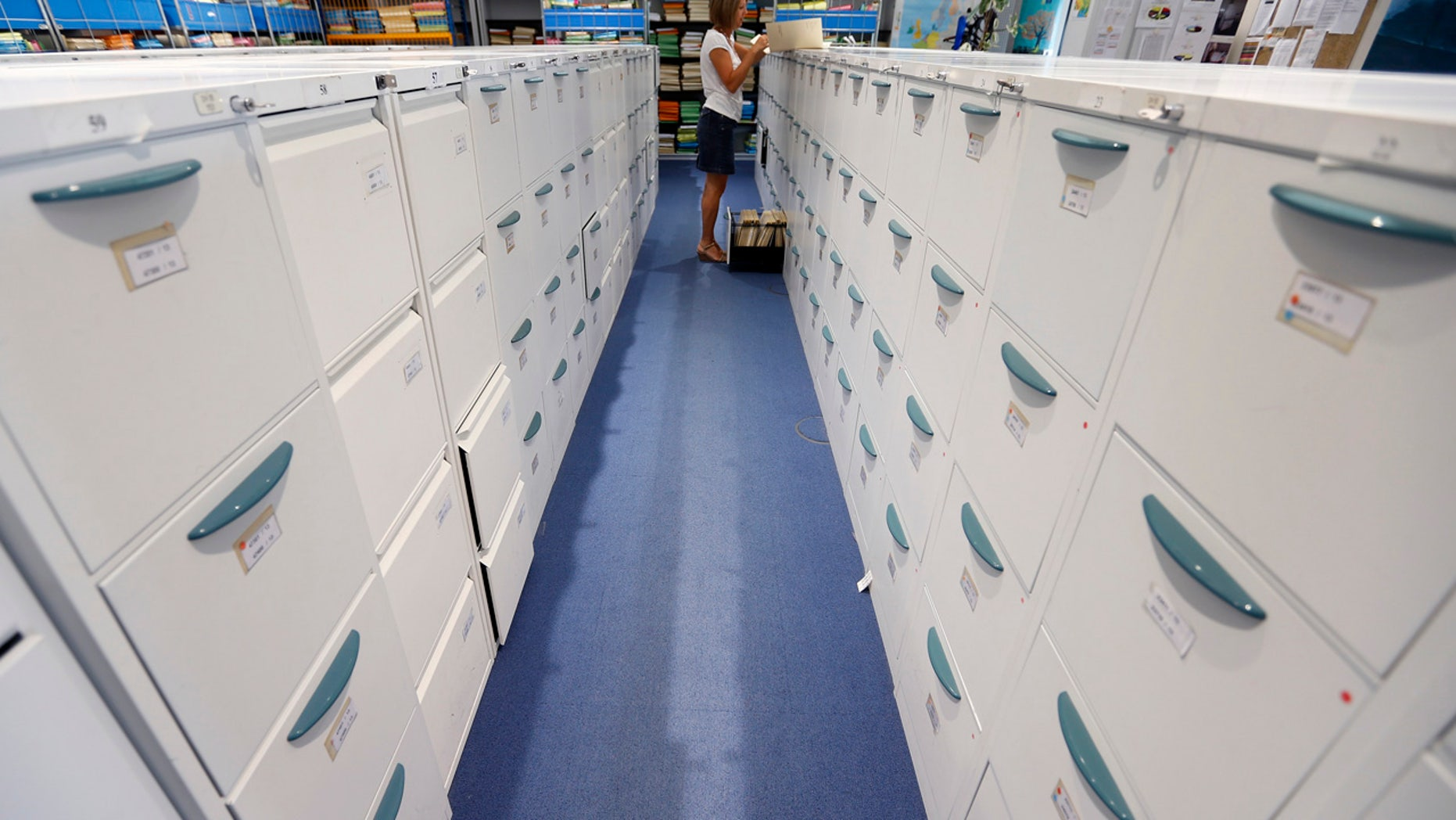 Australian officials are investigating how top-secret documents were left in filing cabinets that were sold at a second-hand shop.