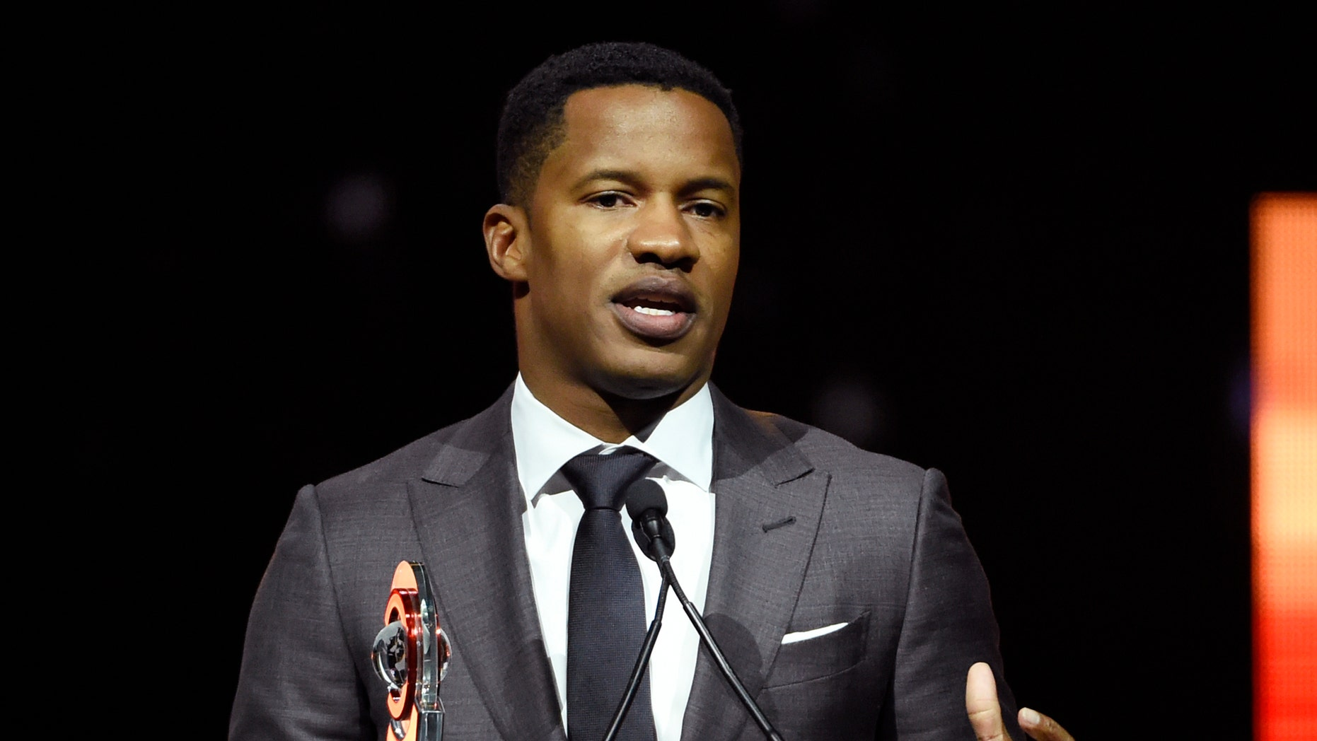"FILE - In this April 14, 2016 file photo, Nate Parker, director of the upcoming film ""The Birth of a Nation,"" accepts the Breakthrough Director of the Year award during the CinemaCon 2016 Big Screen Achievement Awards in Las Vegas. The American Film Institute has canceled plans to screen writer-director Nate Parker's ""The Birth of a Nation"" for students this week amid controversies surrounding a 17 year old rape accusation of Parker and his co-writer. (Photo by Chris Pizzello/Invision/AP, File)"