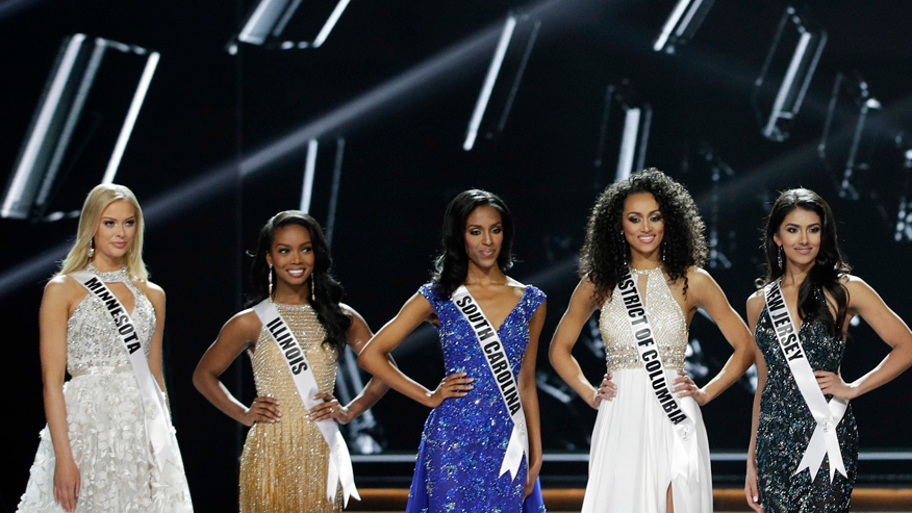 The final five contestants stand on stage during the Miss USA contest Sunday, May 14, 2017, in Las Vegas.