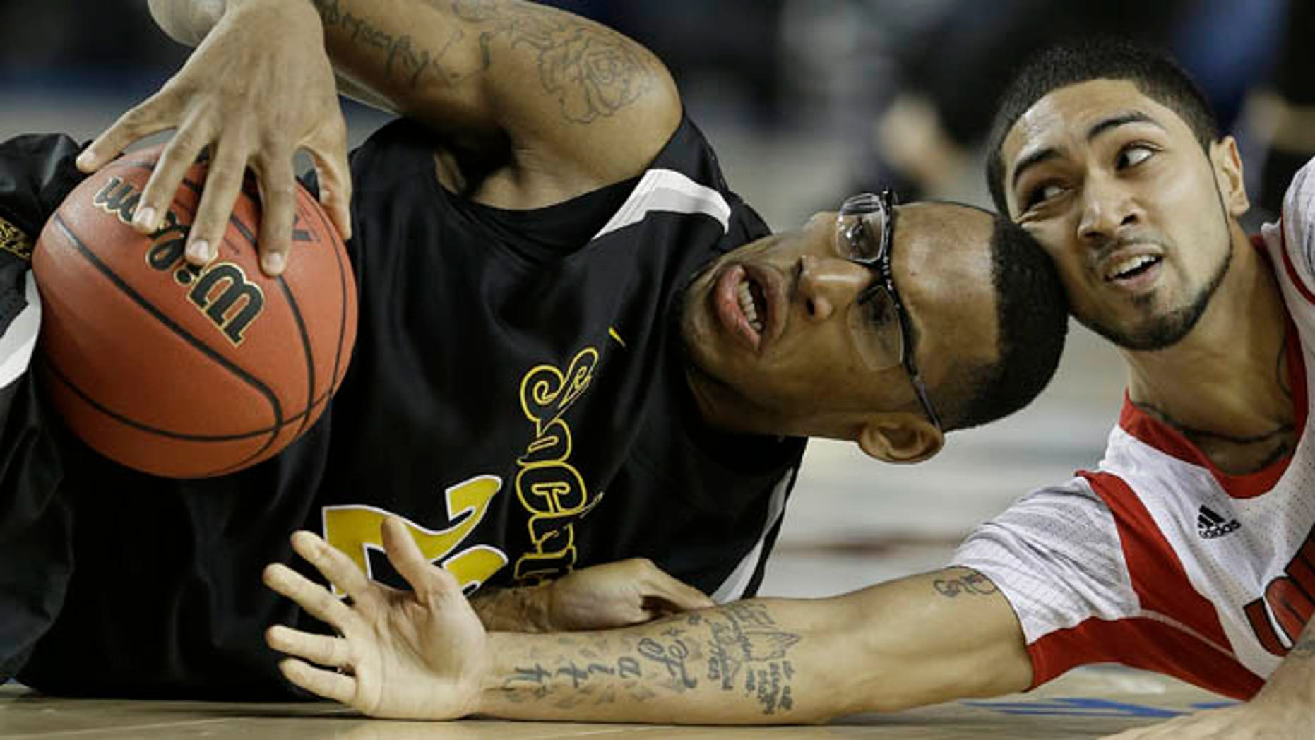 April 6, 2013: Wichita State's Carl Hall (22) and Louisville's Russ Smith (2) vie for a loose ball during the second half of the NCAA Final Four tournament college basketball semifinal game in Atlanta.