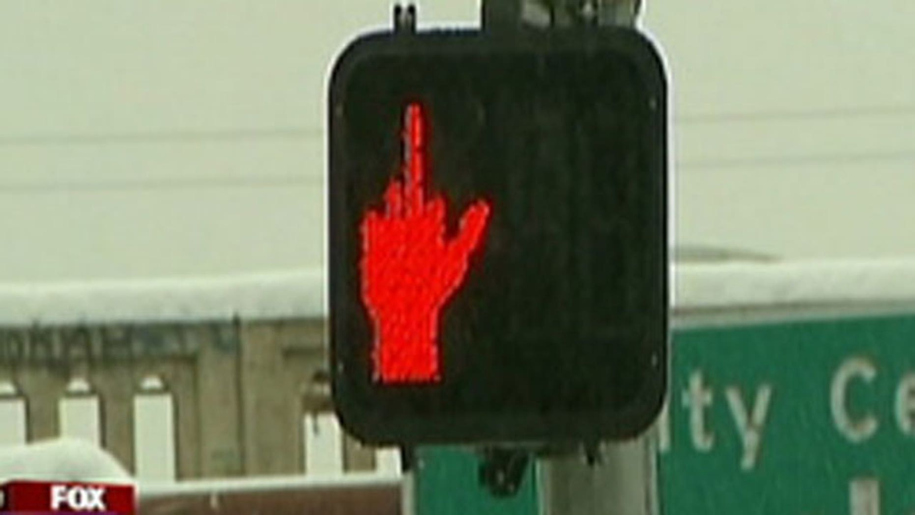 A crosswalk sign in Spokane, Washington was obscured on December 2, 2010 and appeared to be giving pedestrians the middle finger.