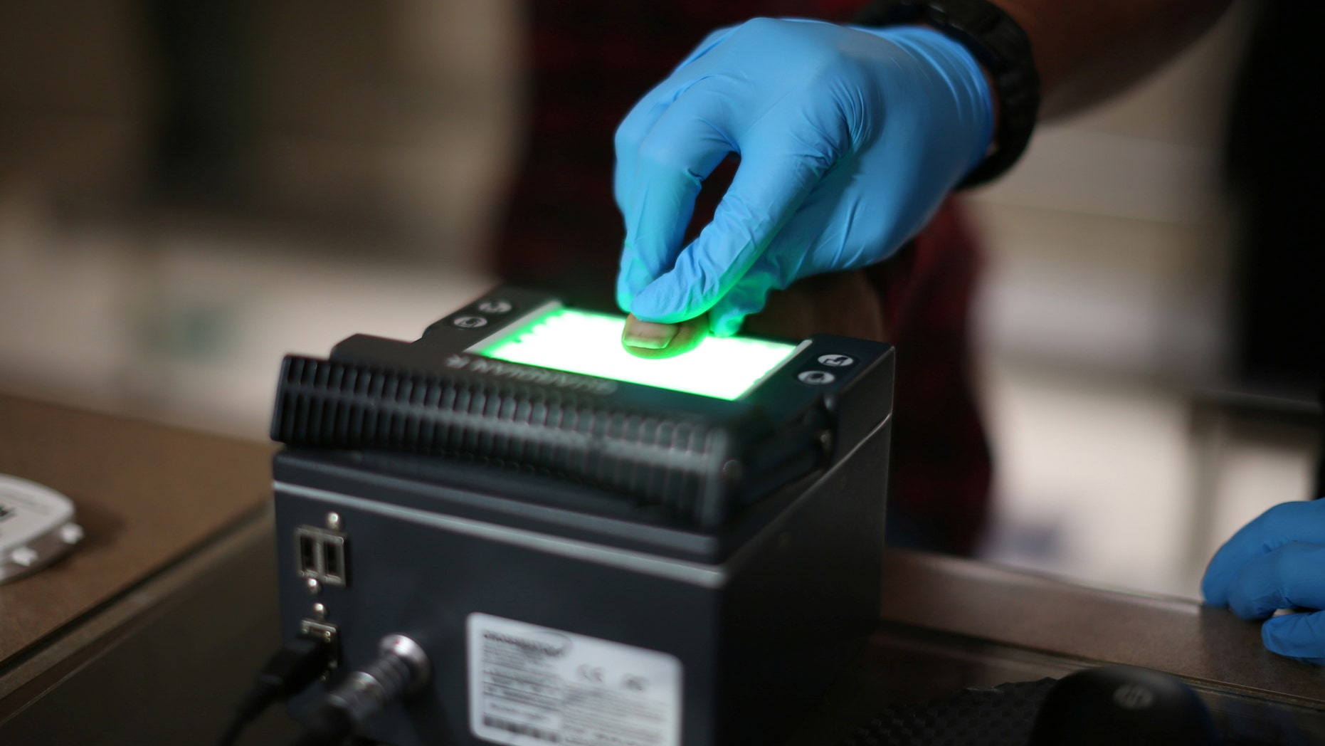 File photo: Mexican national Adalberto Magana-Gonzalez, 44, has his fingerprints taken after being taken into custody by a U.S. Immigration and Customs Enforcement's (ICE) Fugitive Operations team in Santa Ana, California, U.S., May 11, 2017. (REUTERS/Lucy Nicholson)