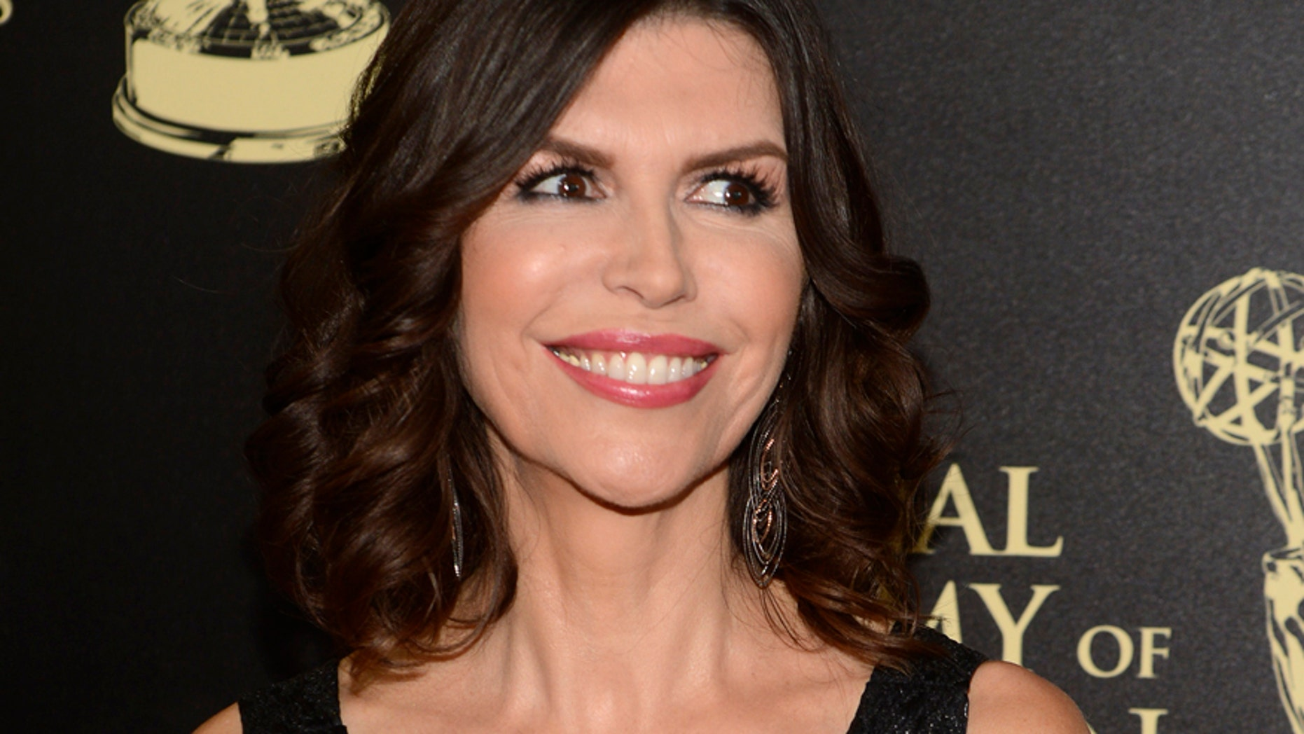 "Finola Hughes, who plays Anna Devane on ""General Hospital,"" arrives at the 41st Annual Daytime Emmy Awards in Beverly Hills, California June 22, 2014."