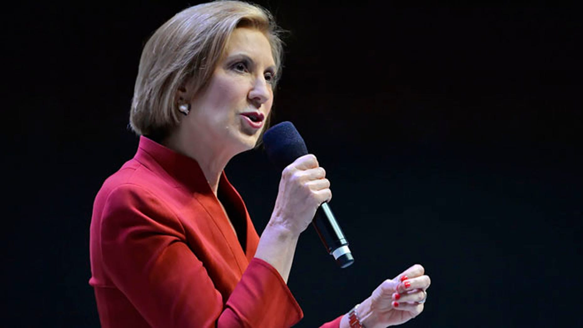 Republican presidential candidate Carly Fiorina speaks at a presidential forum sponsored by Heritage Action at the Bon Secours Wellness Arena, Friday, Sept. 18, 2015, in Greenville, S.C. (AP Photo/Richard Shiro)