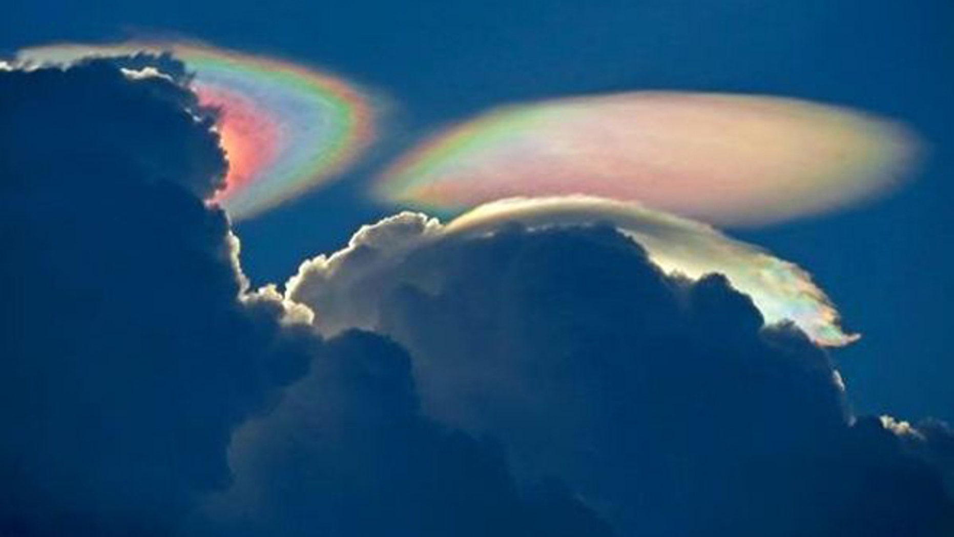 """July 31, 2012: This """"fire rainbow,"""" or iridescent cloud, was captured over South Florida."""
