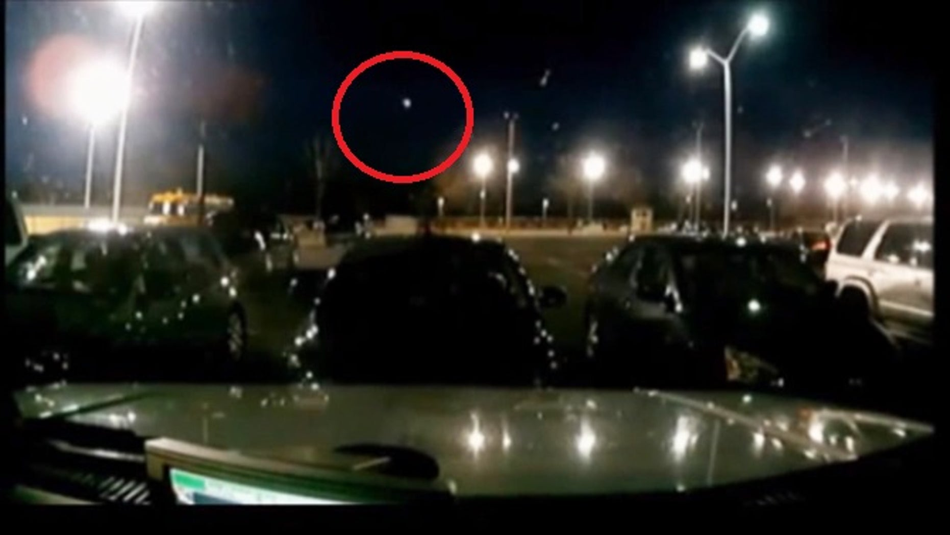 A screen grab from a stationary camera in a parking lot appears to show a fireball streaking across the sky over Southern California.