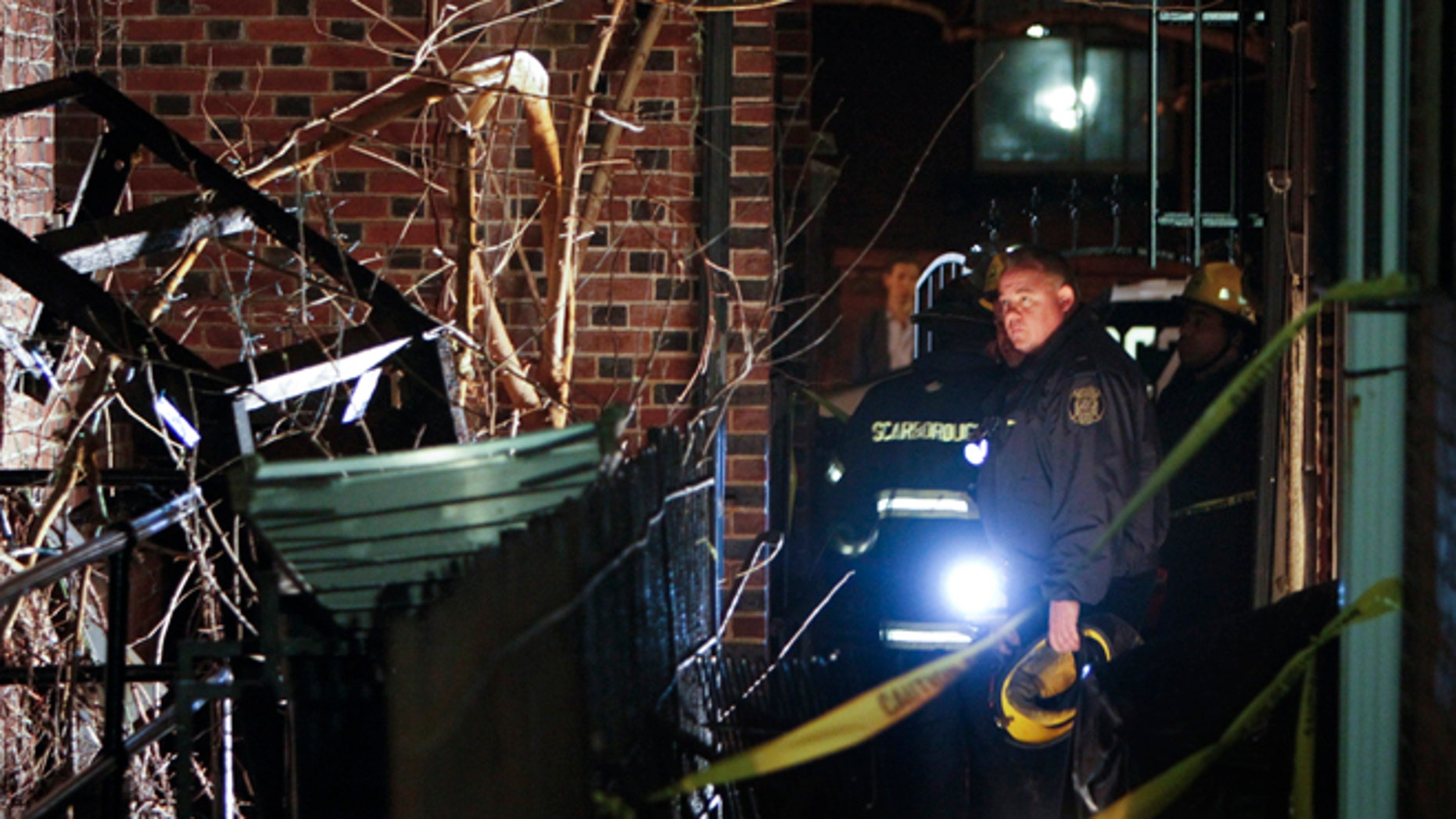 Jan. 12, 2014: Firefighters look up at the fire escape landing that collapsed around midnight Saturday in the Rittenhouse Square section of Philadelphia.