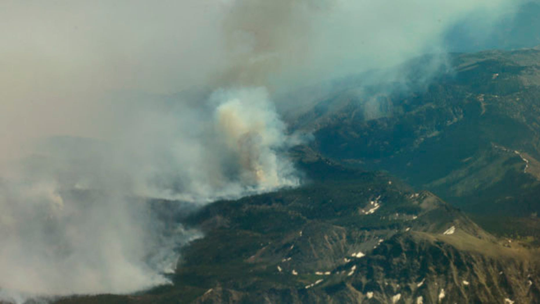 July 18, 2014: The Chiwaukum Creek Fire near Leavenworth, Wash. is viewed from a plane carrying Washington Gov. Jay Inslee on a tour of areas being affected by wildfires. (AP)