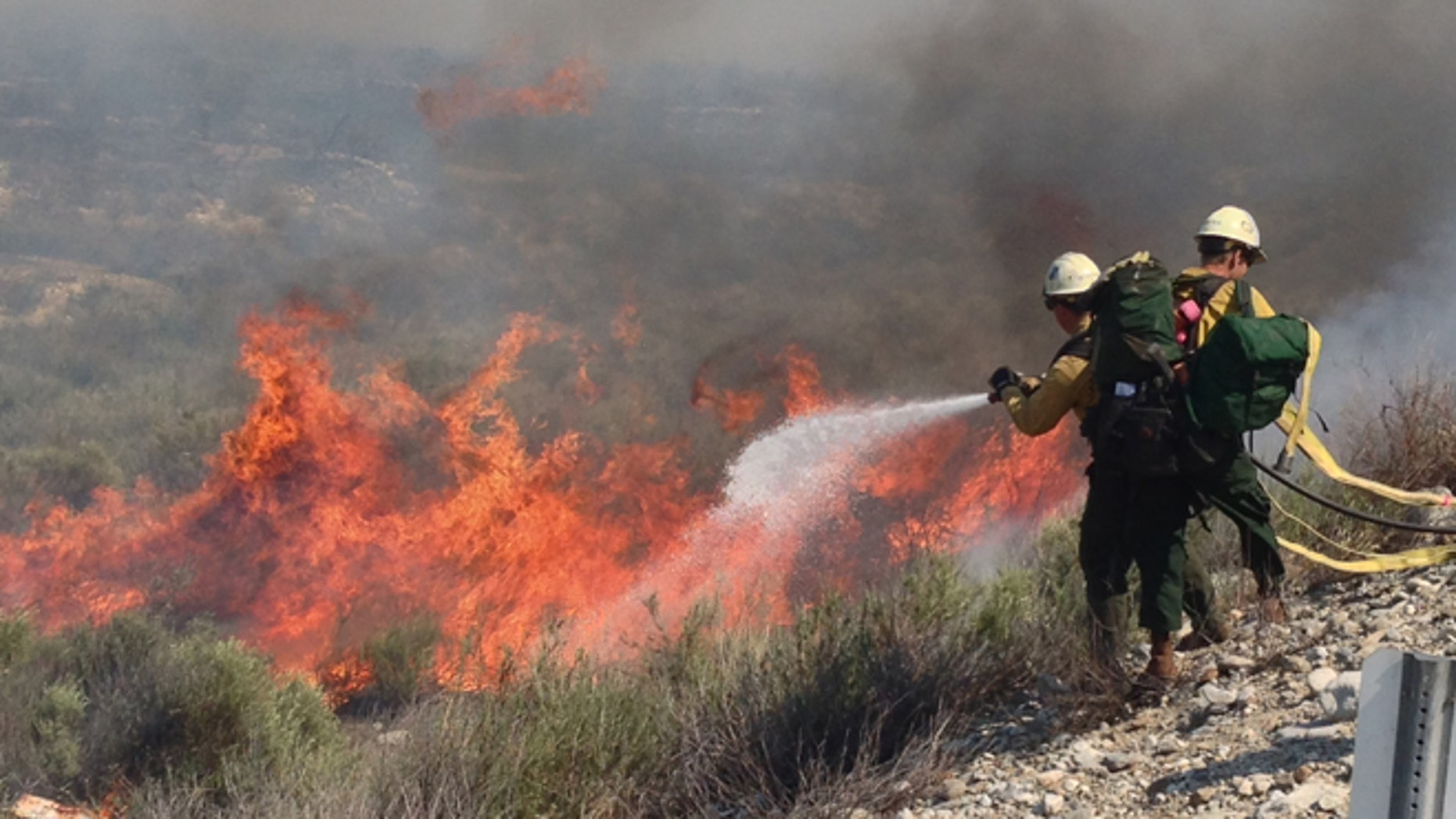 Apr. 30, 2014: Firefighters battle wildfire in Southern California.