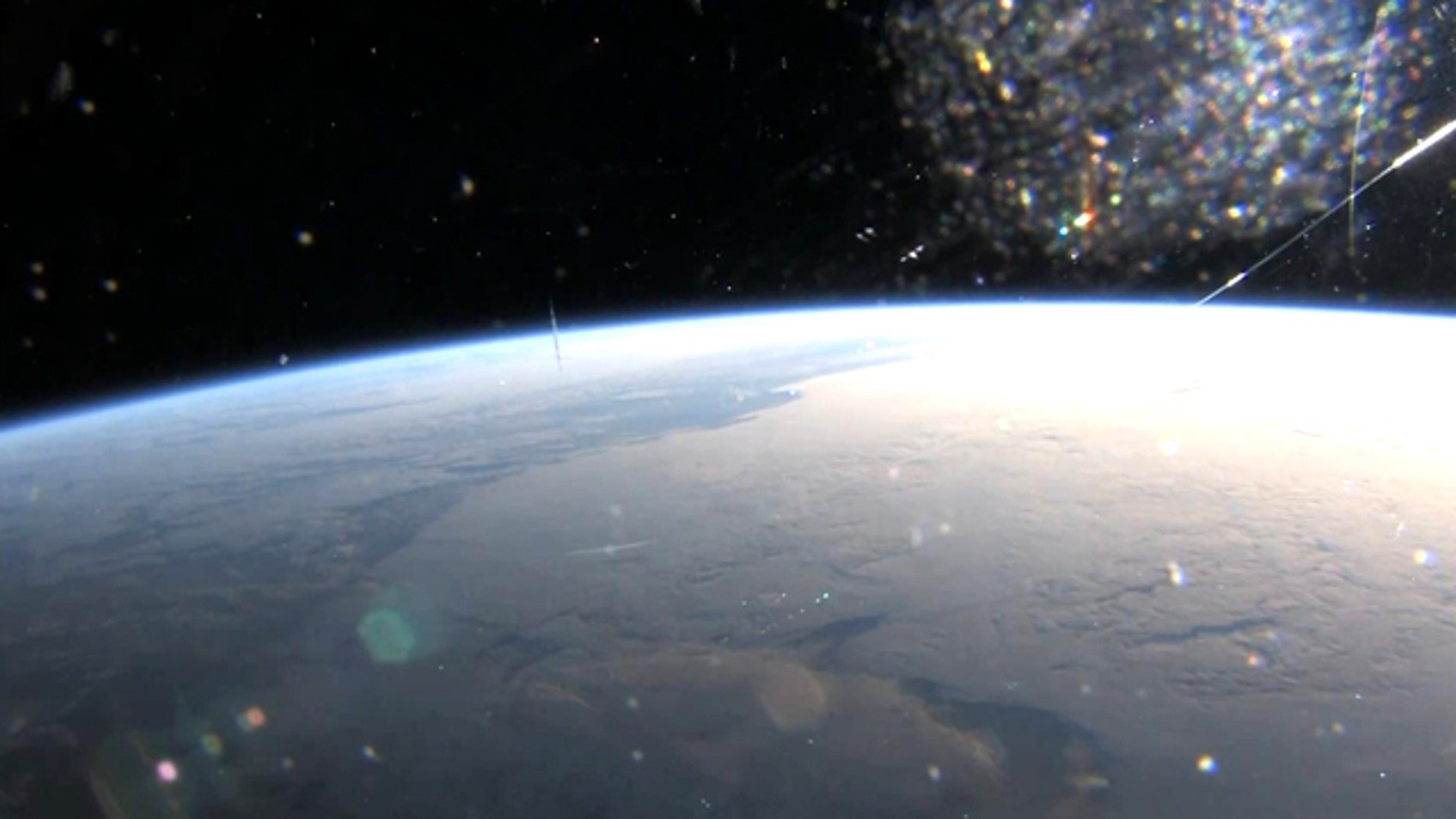 a screenshot from First Orbit, a new film that seeks to replicate the experience of Yuri Gagarin's famous first flight in space by combining archival audio with new footage from space.