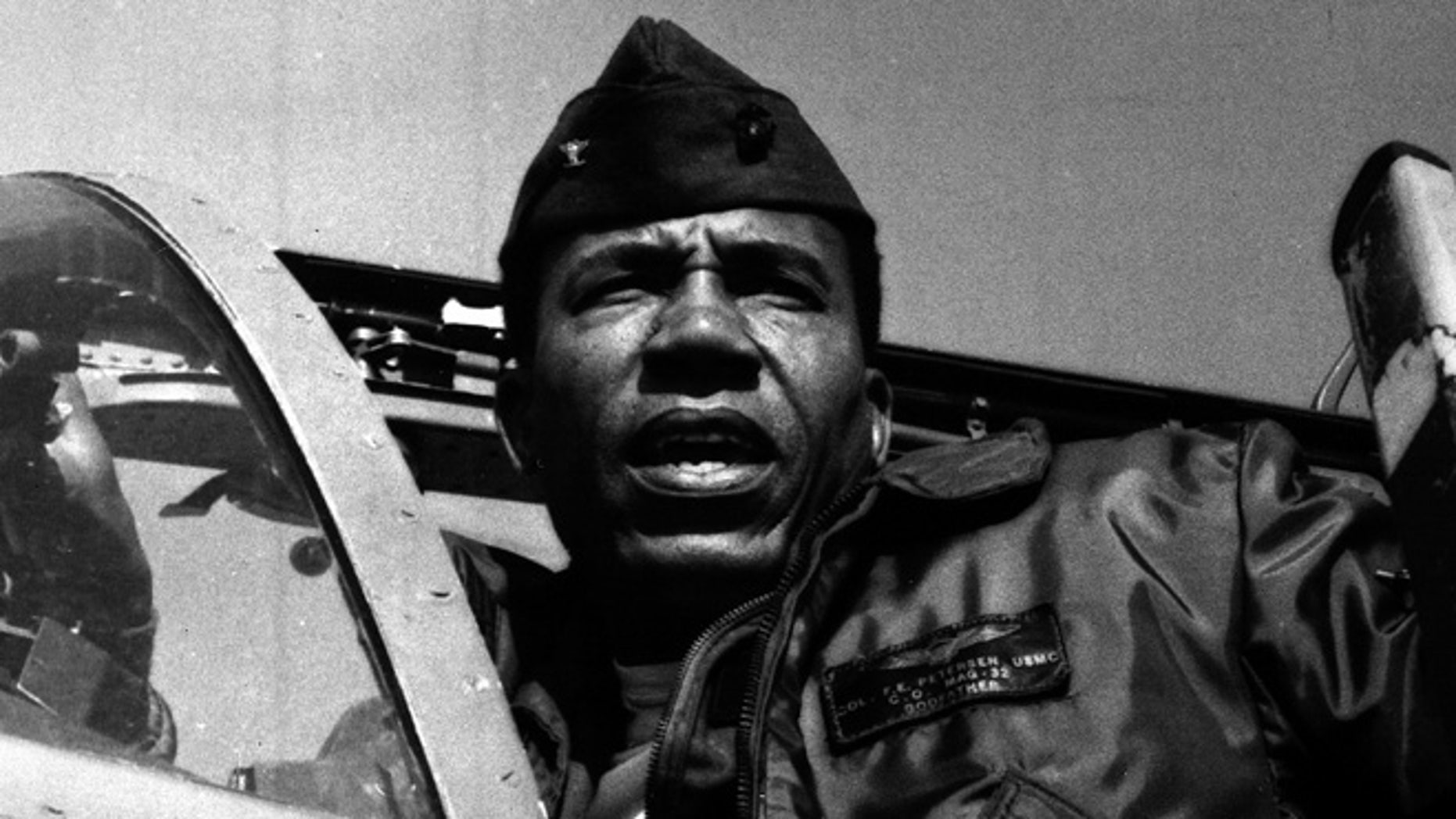 This undated photo provided by the Marine Corps shows Lt. Gen. Frank E. Petersen, Jr., the first black aviator and brigadier general in Marine Corps.