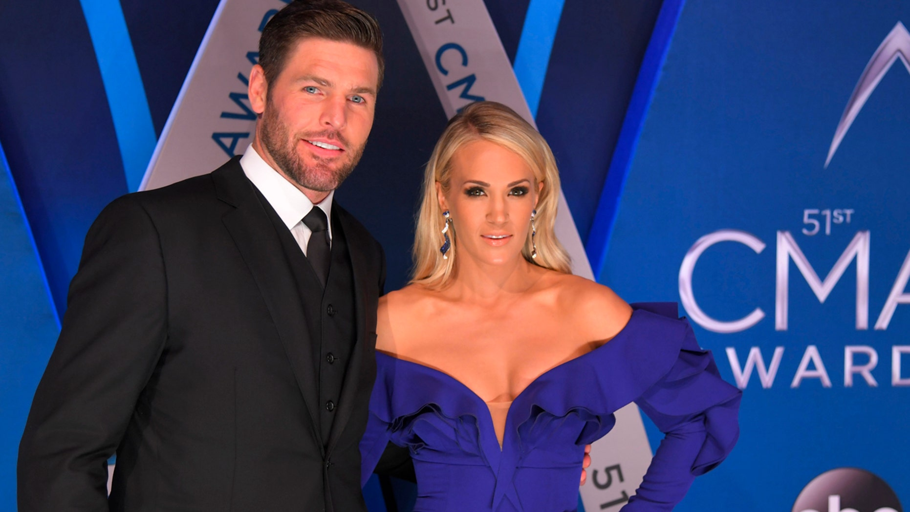 Singer Carrie Underwood and Mike Fisher attend the 51st Country Music Association Awards in Nashville, Tennessee in 2017.