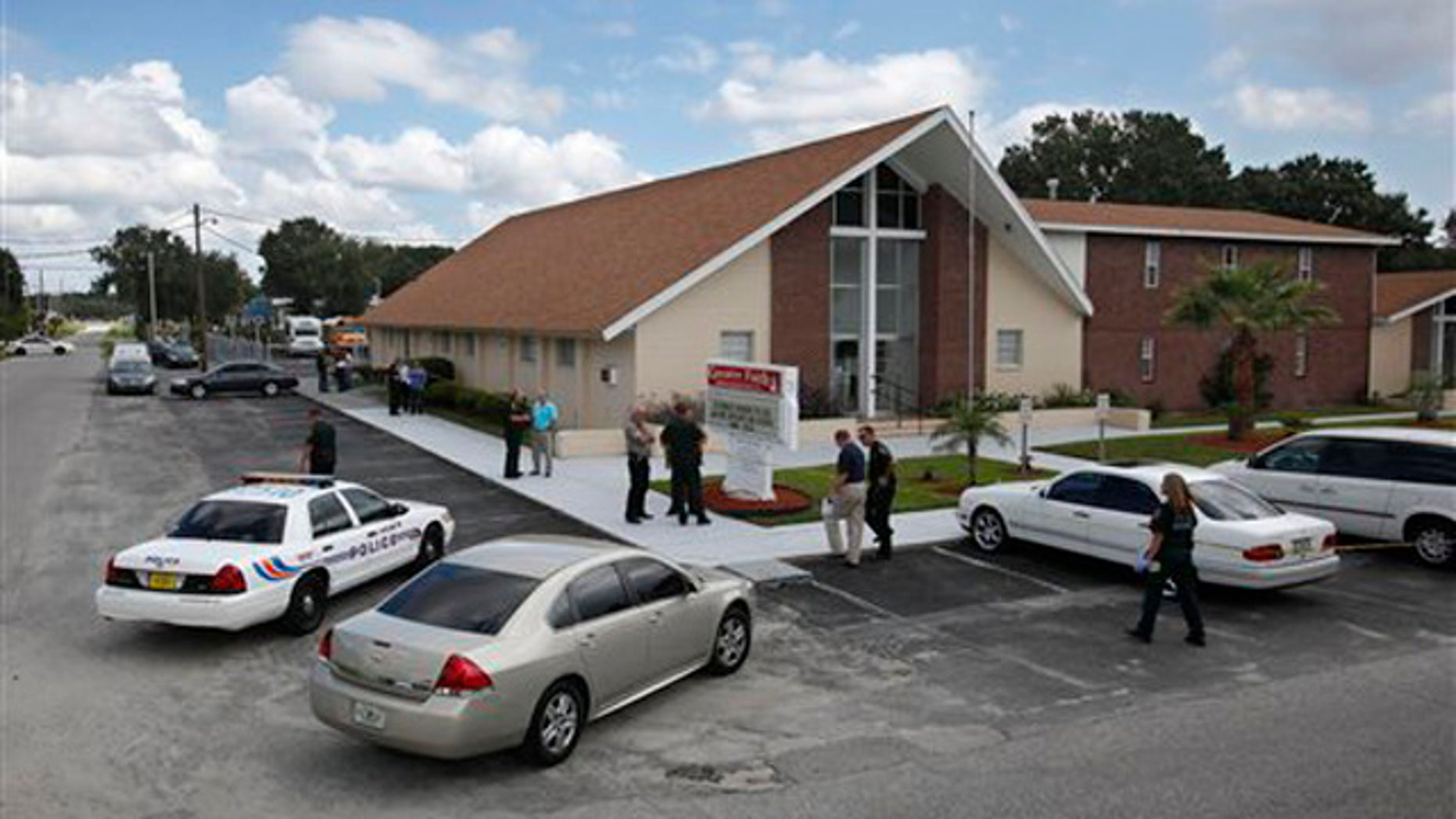 Lakeland Police and Polk County Sheriff's Deputies investigate a shooting in Lakeland, Fla. on Sunday, Sept. 18, 2011