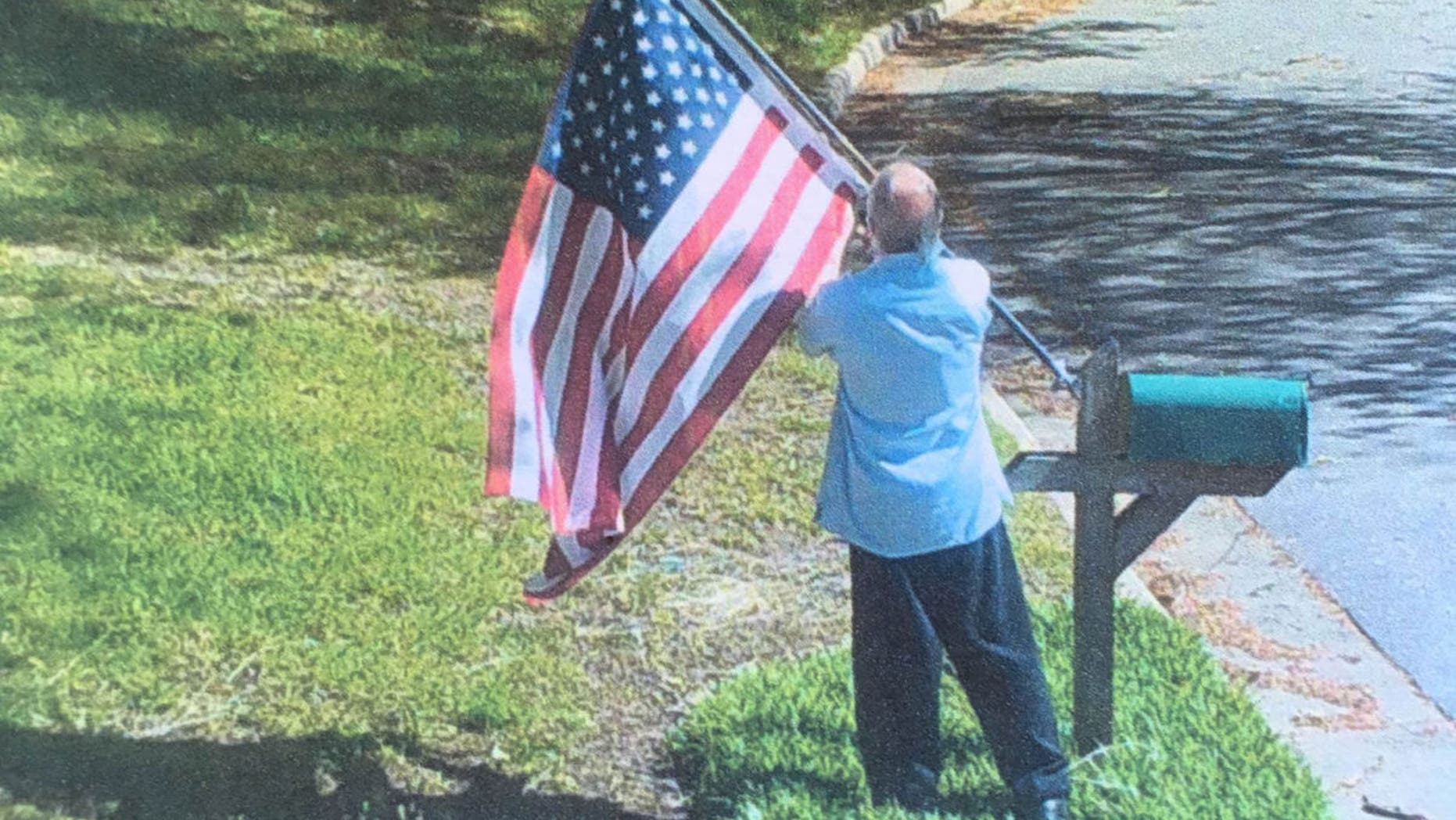 Anderson submitted evidence showing Parmele taking the flag.