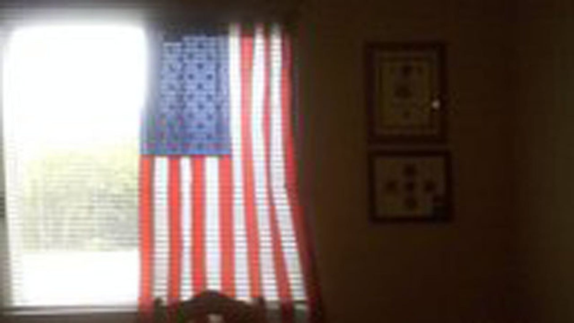 """Charlie Price, 28, of Oshkosh, Wis., and officials at Midwest Realty Management have come to a """"mutual agreement"""" that allows the veteran to continue displaying the patriotic symbol"""