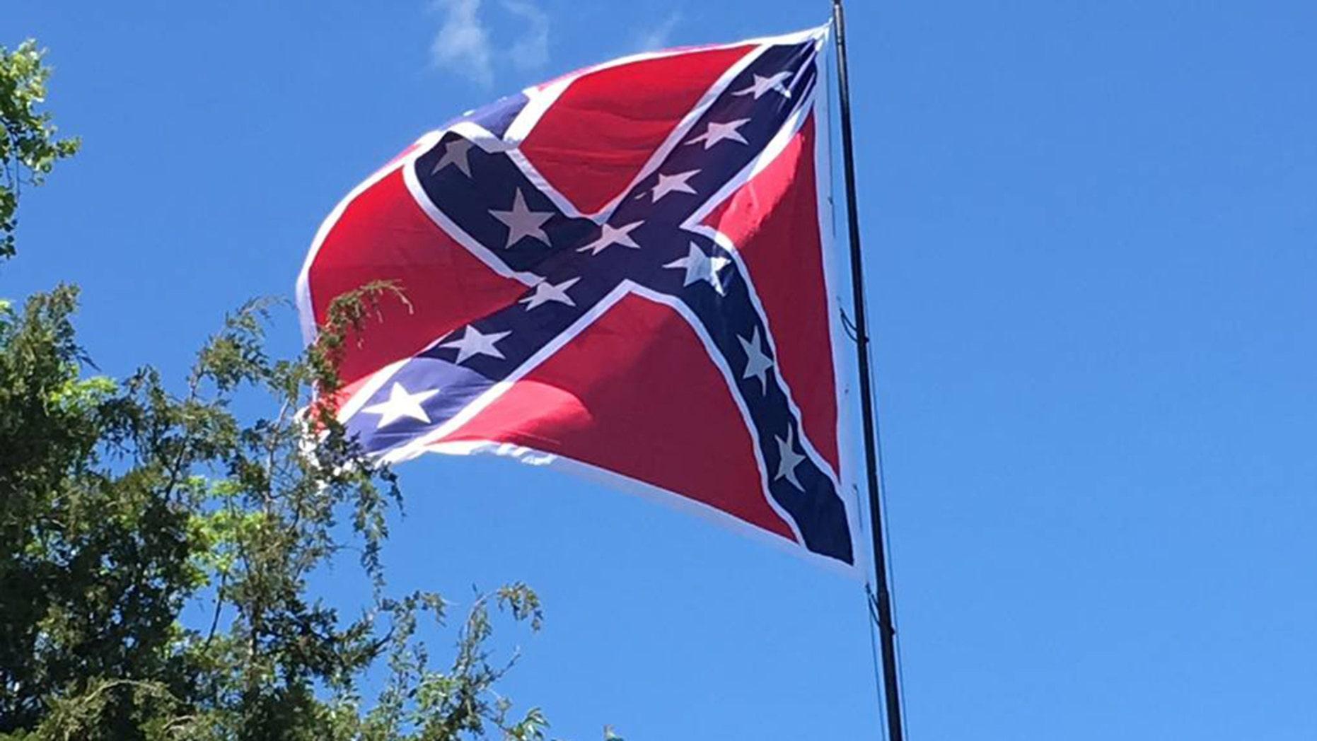 A Confederate flag flies over U.S. Highway 70 in Orange County, N.C.